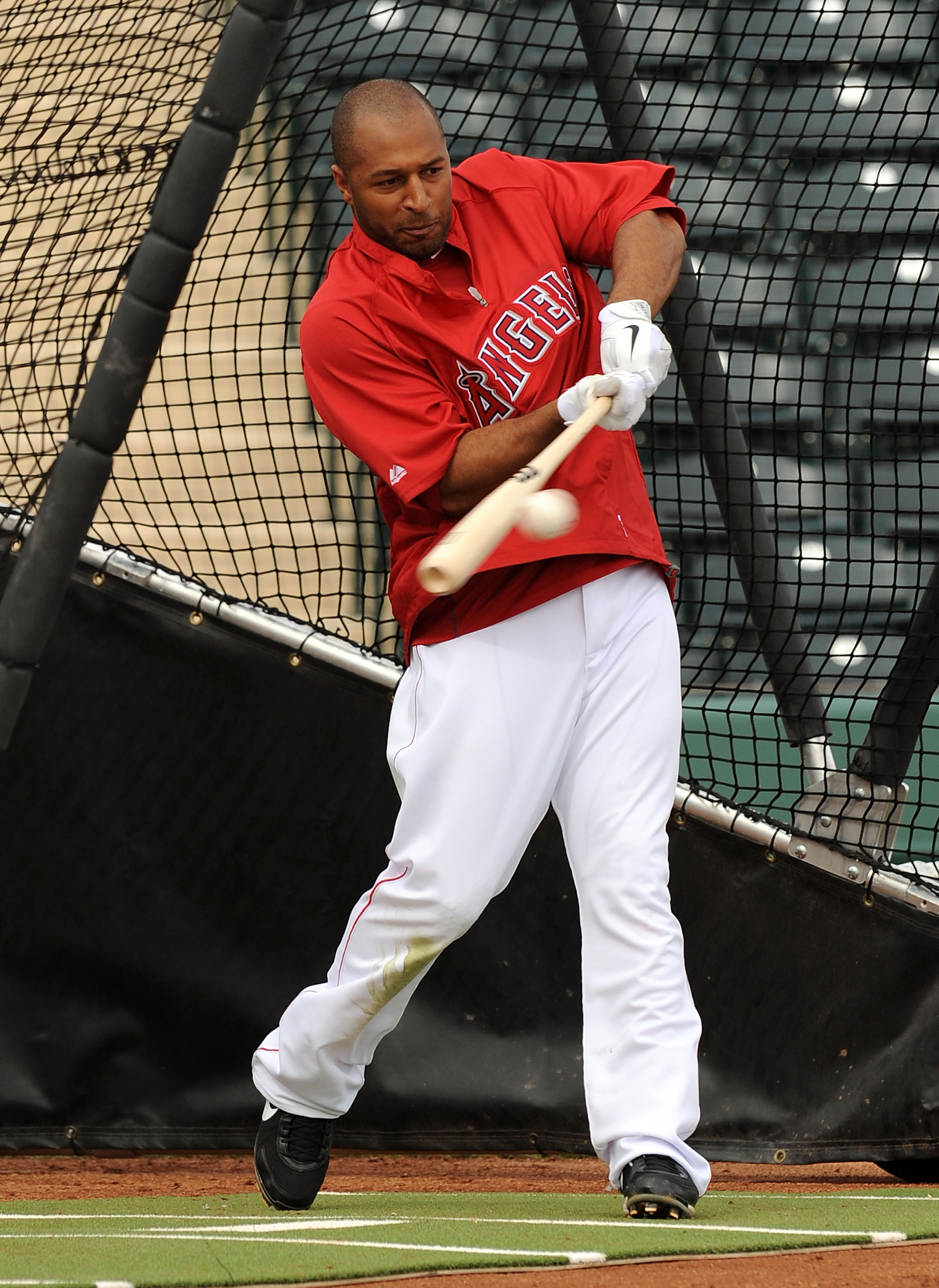 TEMPE, AZ - FEBRUARY 26:  Vernon Wells #10 of the Los Angeles Angels of Anaheim takes batting practice prior to the Los Angeles Dodgers game at Tempe Diablo Stadium on February 26, 2011 in Tempe, Arizona.  (Photo by Norm Hall/Getty Images)