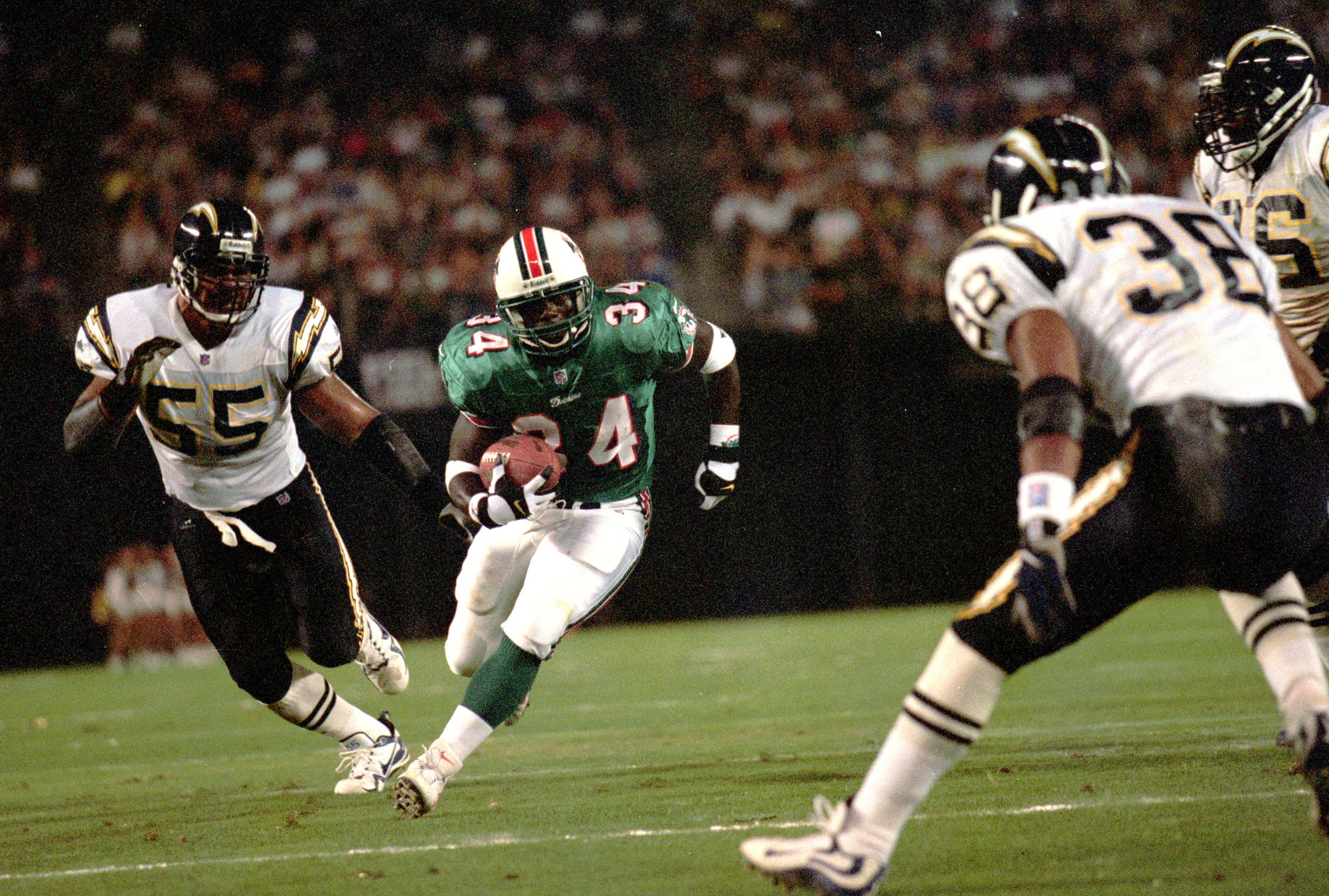 21 Aug 1999:  Cecil Collins #34 of the Miami Dolphins battles the San Diego Chargers at Qualcomm Stadium in San Diego, California. The Dolphins defeated the Chargers 13-10. Mandatory Credit: Tom Hauck/Allsport