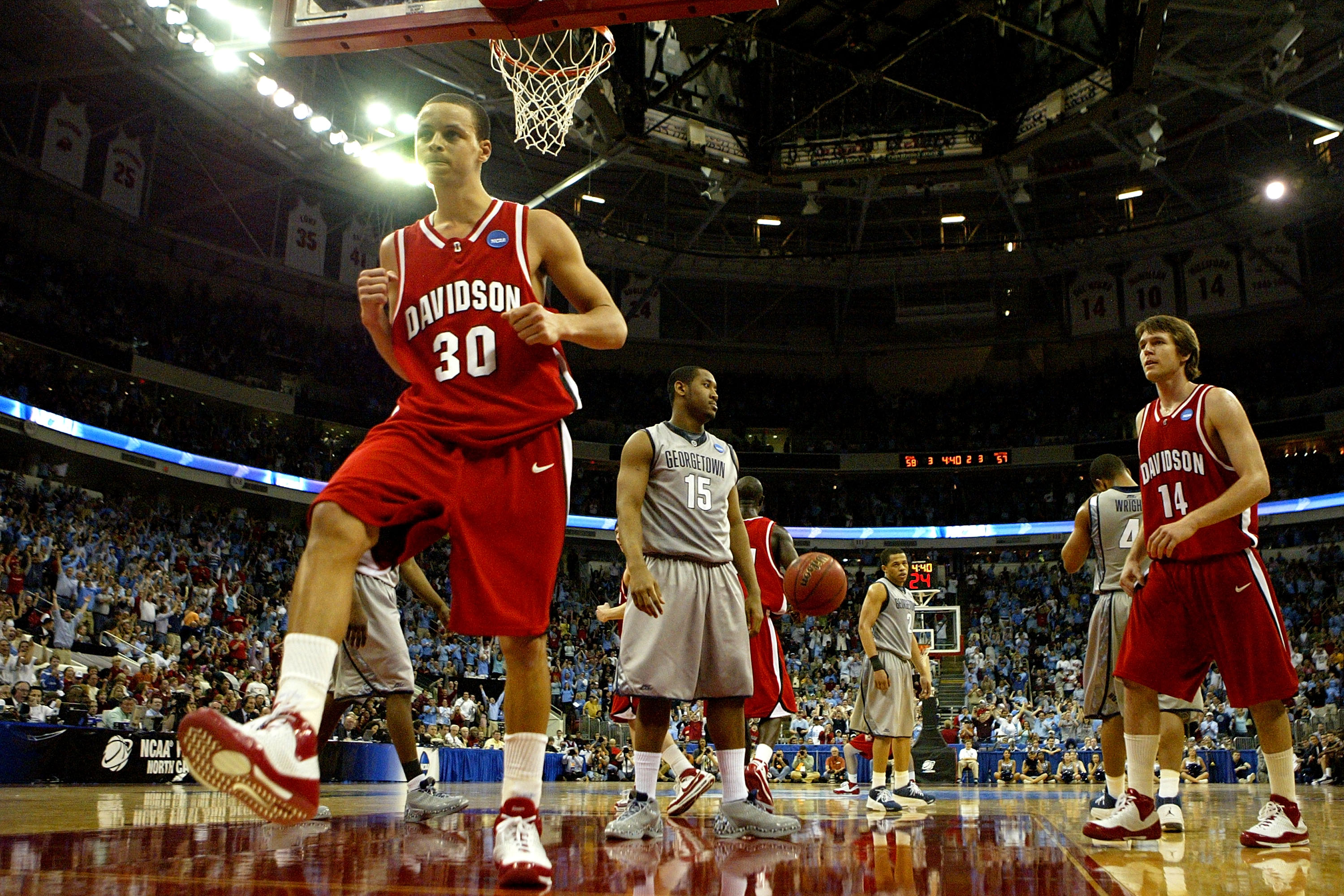 RALEIGH, NC - MARCH 23:  Stephen Curry #30 of the Davidson Wildcats celebrates after a basket against the Georgetown Hoyas during the second round of the 2008 NCAA Men's Basketball Tournament Midwest Regionals on March 23, 2008 at RBC Center in Raleigh, N