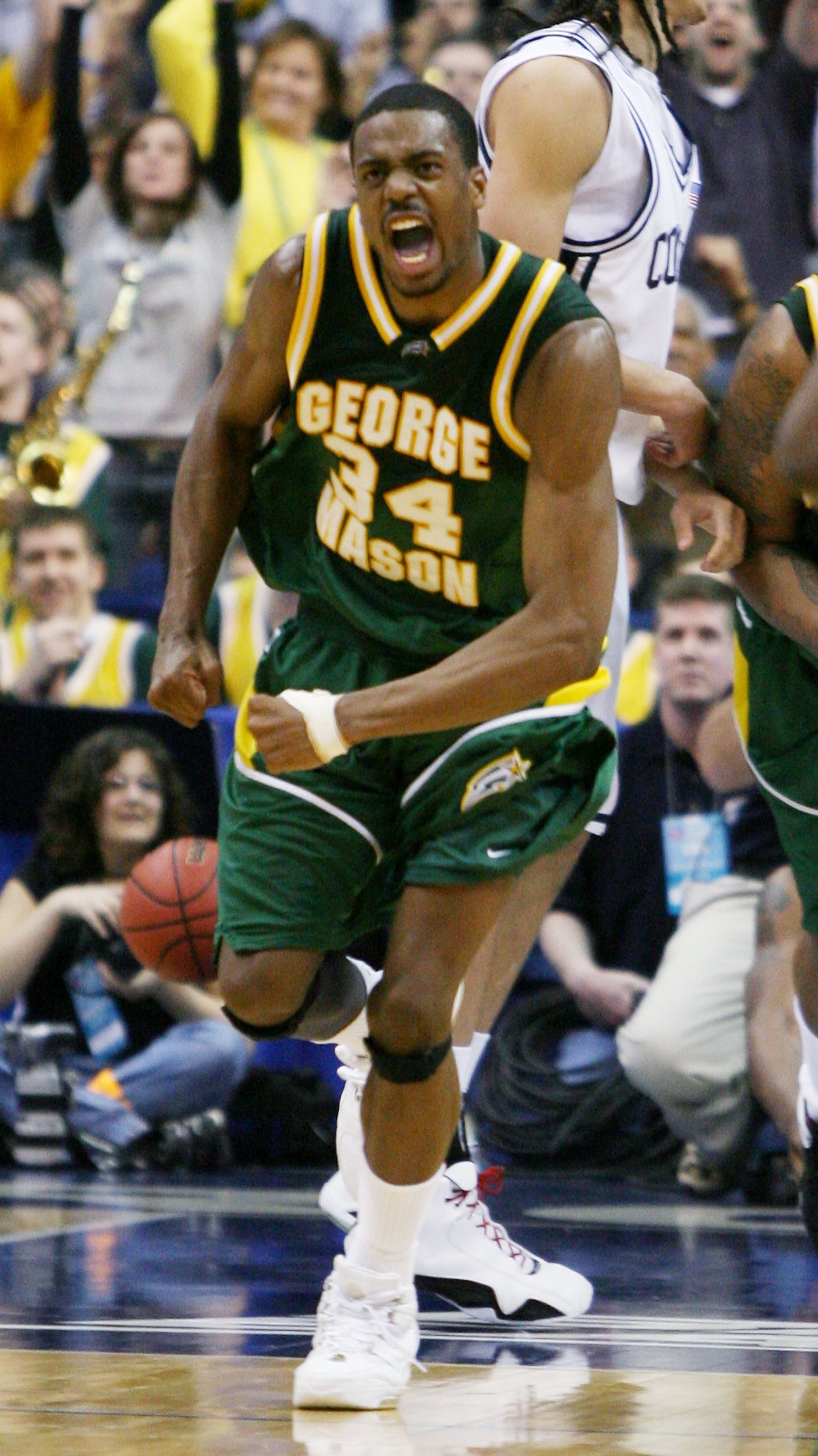 WASHINGTON - MARCH 26: Will Thomas #34 of the George Mason Patriots celebrates late in the second half of their overtime victory over the Connecticut Huskies during the Regional Finals of the NCAA Men's Basketball Tournament on March 26, 2006 at the Veriz