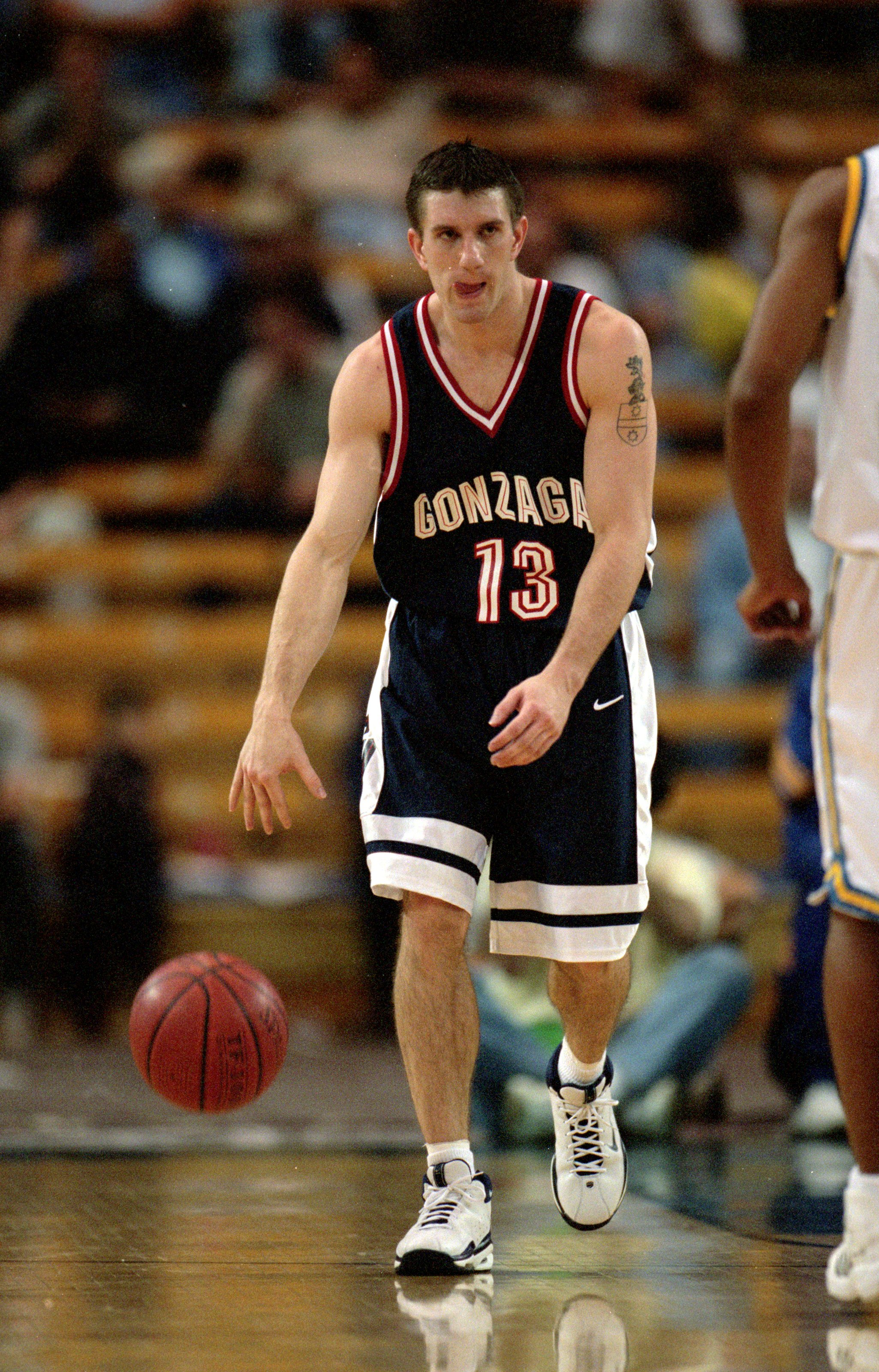 11 Dec 1999: Matt Santangelo #13 of the Gonzaga Bulldogs dribbles the ball down court during the game against the  UCLA Bruins at the Pauley Pavillion in Westwood, California. The Bulldogs defeated the Bruins 59-43. Mandatory Credit: Jeff Gross  /Allsport