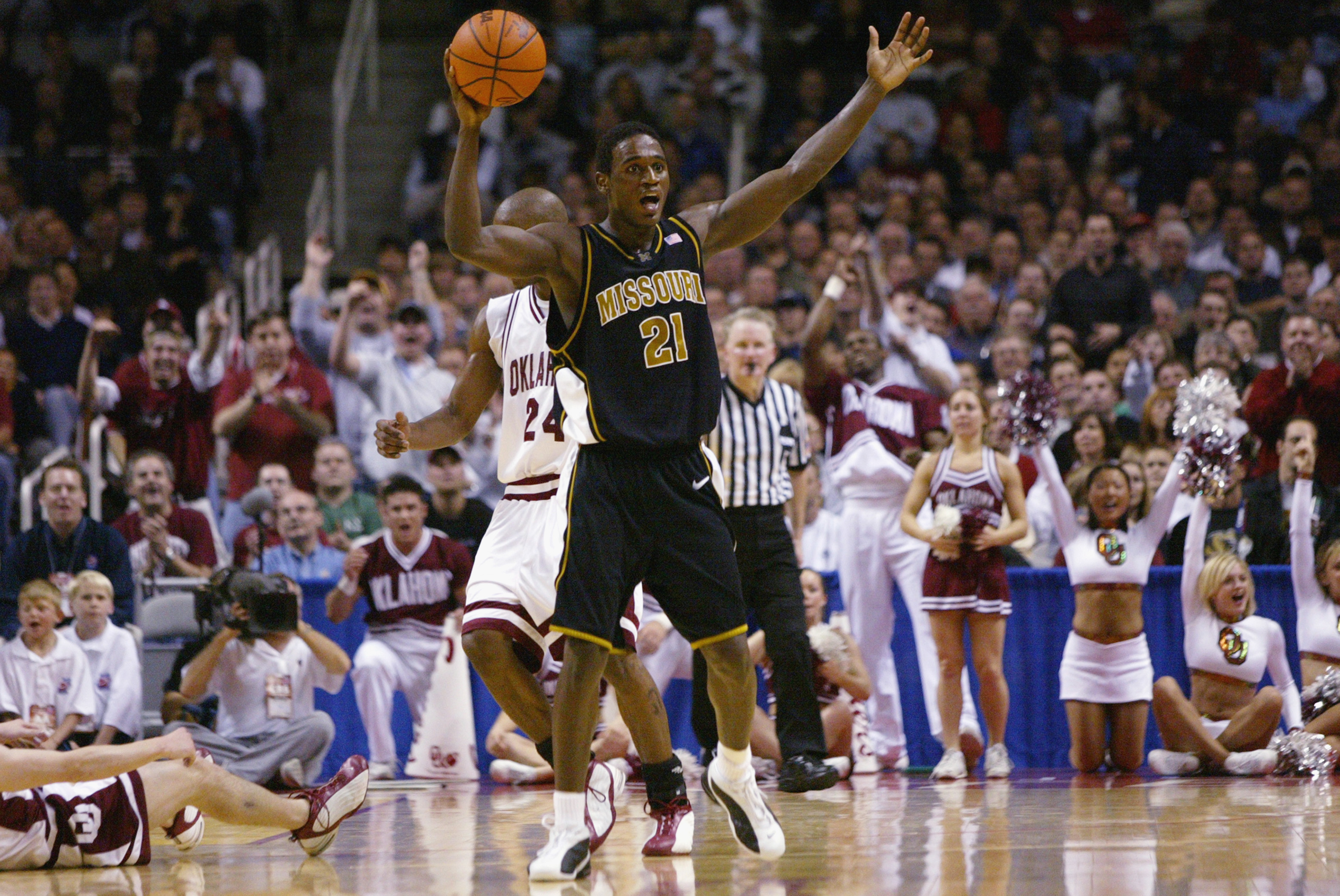 SAN JOSE, CA - MARCH 23:  Kareem Rush #21 of the Missouri Tigers argues a call during the West Regional Final of the 2002 NCAA Men's Basketball Tournament against the Oklahoma Sooners on March 23, 2002 at Compaq Center in San Jose, California.  The Sooner