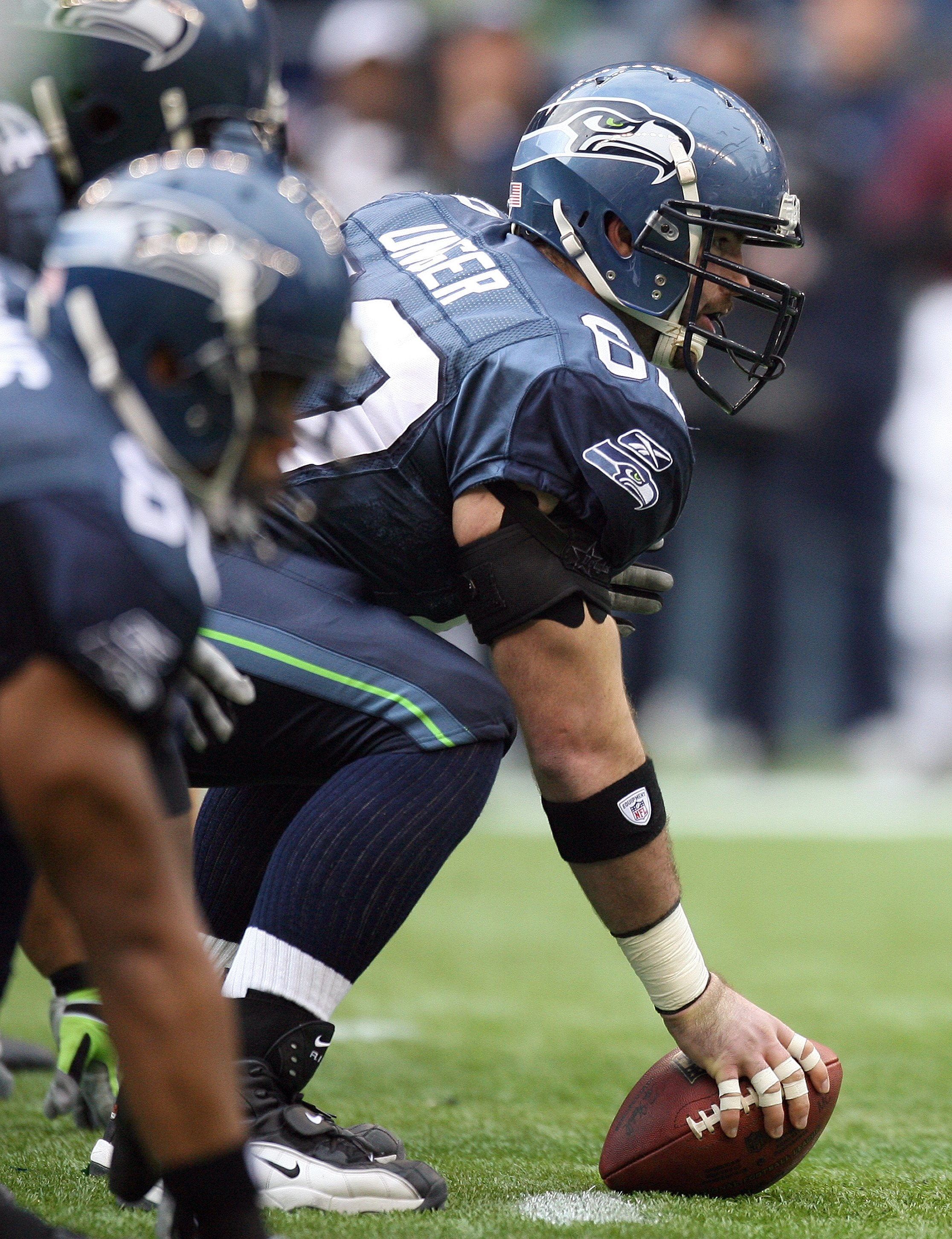 SEATTLE - DECEMBER 20:  Center Max Unger #60 of the Seattle Seahawks lines up against the Tampa Bay Buccaneers defense during their game on December 20, 2009 at Qwest Field in Seattle, Washington. The Buccaneers defeated the Seahawks 24-7. (Photo by Otto