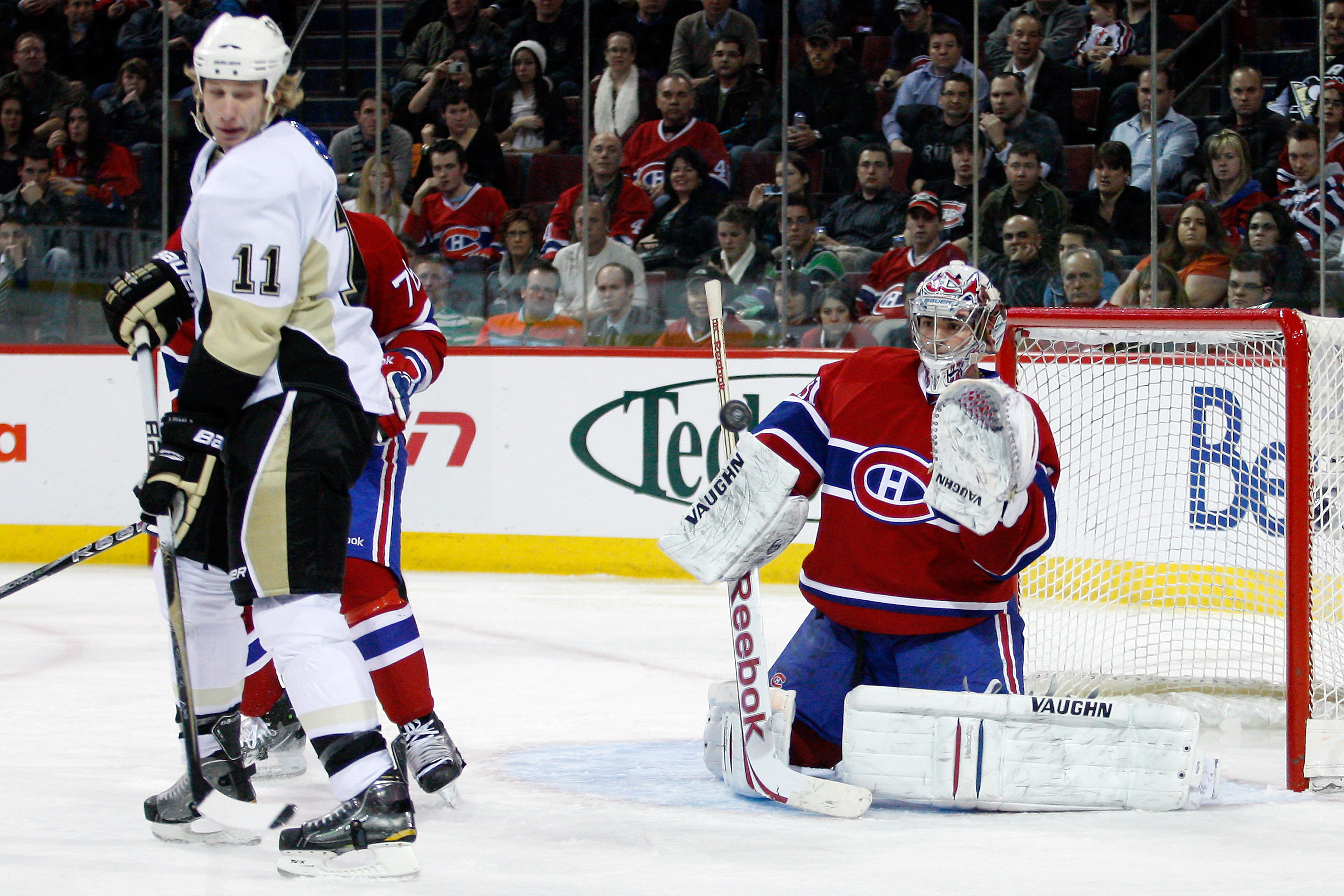 MONTREAL, CANADA - JANUARY 12:  Carey Price #31 of the Montreal Canadiens makes a glove save on the deflected puck by Jordan Staal #11 of the Pittsburgh Penguins during the NHL game at the Bell Centre on January 12, 2011 in Montreal, Quebec, Canada.  The