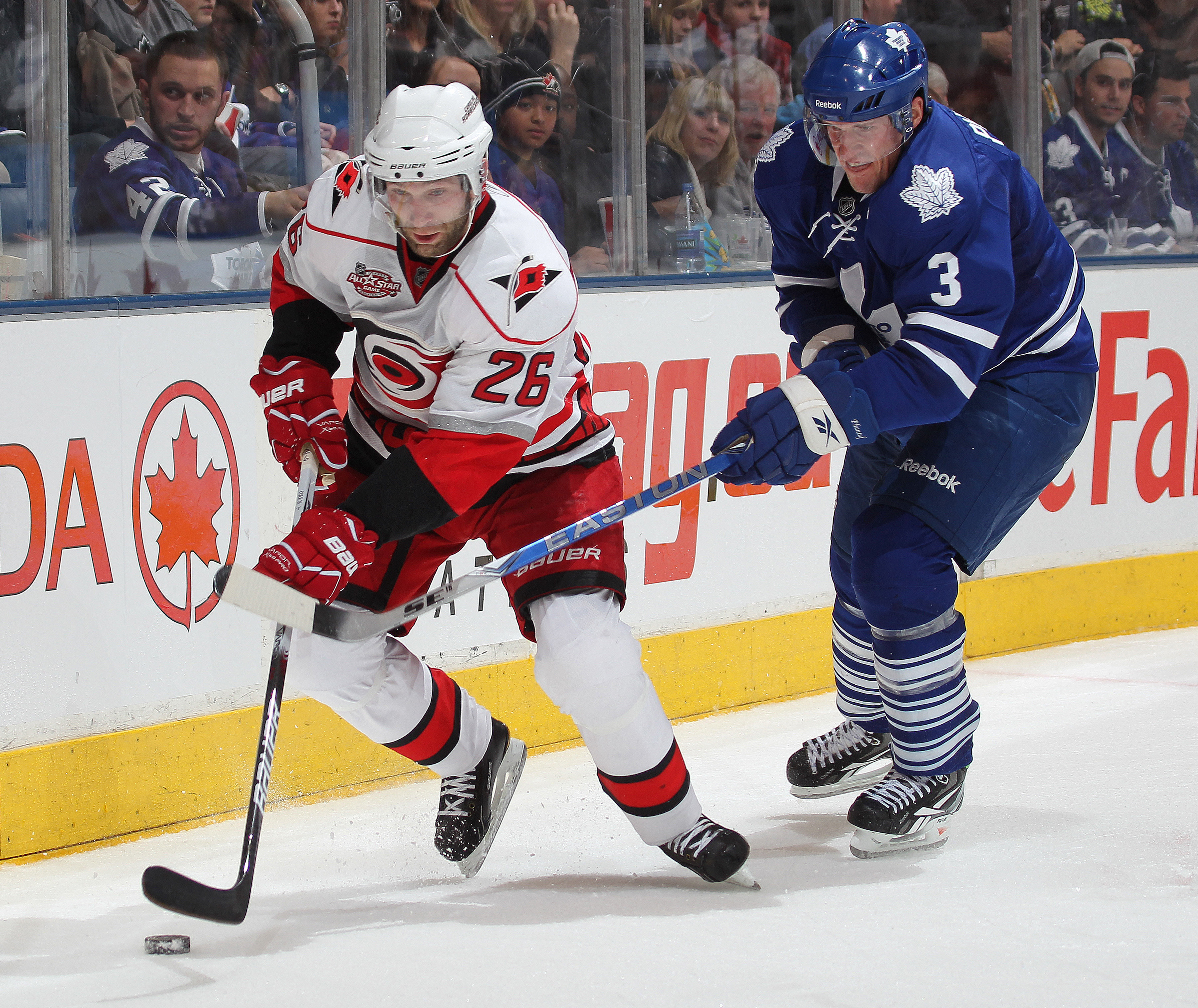 TORONTO, ON - DECEMBER 28:  Erik Cole #26 of the Carolina Hurricanes skates away from the check of Dion Phaneuf #3 of the Toronto Maple Leafs in a game on December 28, 2010 at the Air Canada Centre in Toronto,Ontario. The Hurricanes defeated the Leafs 4-3