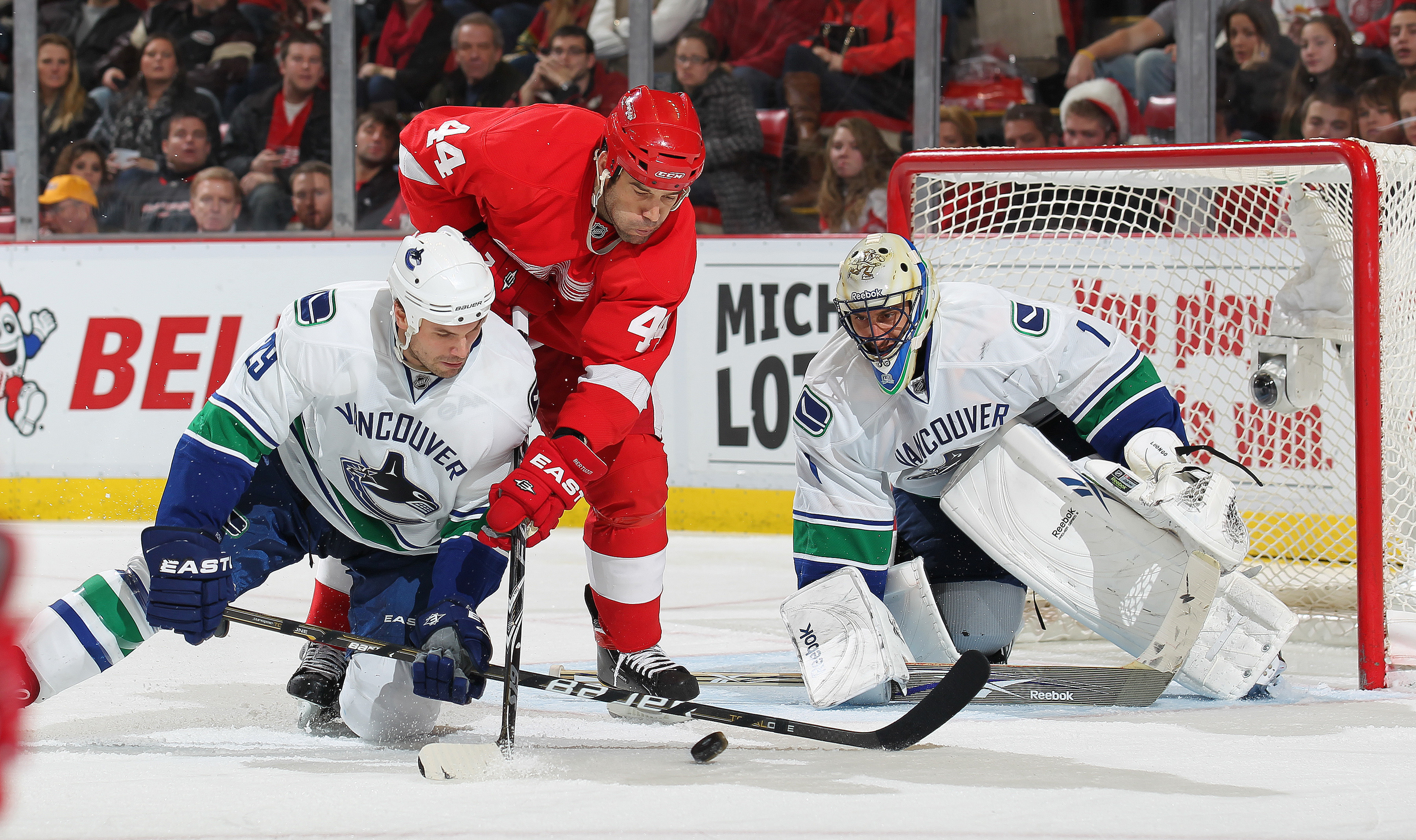 DETROIT, MI - DECEMBER 22:  Roberto Luongo #1 and Aaron Rome #29  of the Vancouver Canucks stop a scoring attempt by Todd Bertuzzi #44 of the Detroit Red Wings on December 22, 2010 at the Joe Louis Arena in Detroit, Michigan. The Wings defeated the Canuck