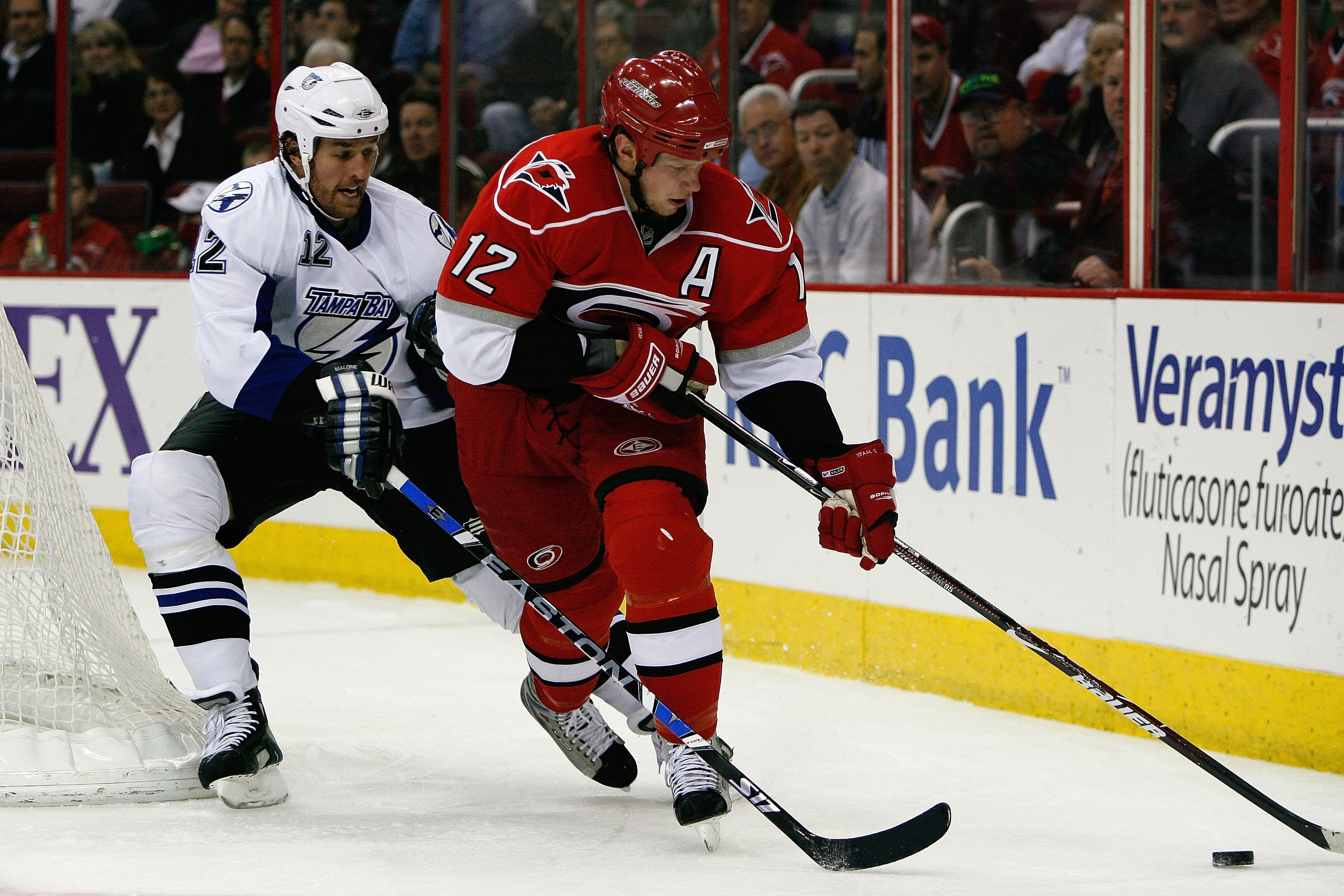 RALEIGH, NC - FEBRUARY 20:  Eric Staal #12 of the Carolina Hurricanes skates with the puck against Ryan Malone #12 of the Tampa Bay Lightning during the game on February 20, 2009 at RBC Center in Raleigh, North Carolina.  (Photo by Kevin C. Cox/Getty Imag