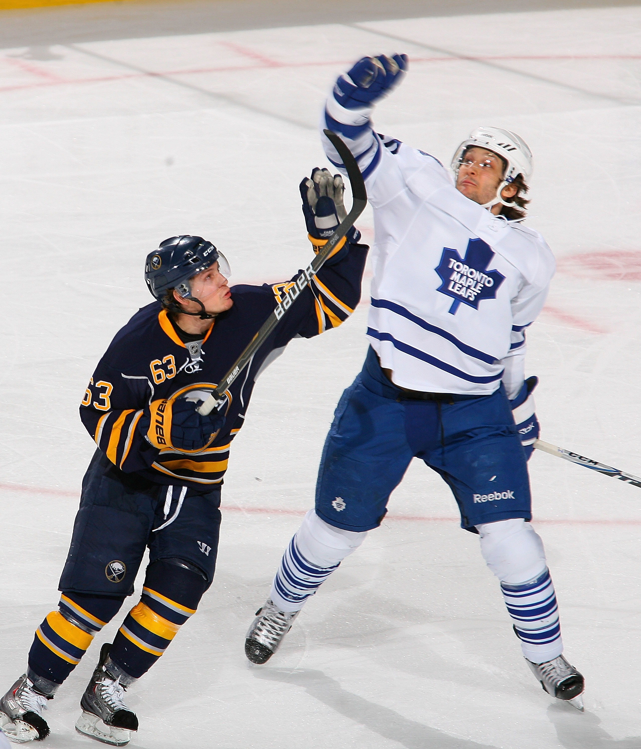BUFFALO, NY - FEBRUARY 16: Tyler Ennis #63 of the Buffalo Sabres and Christian Hanson #20 of the Toronto Maple Leafs try to knock the puck out of the air at HSBC Arena on February 16, 2011 in Buffalo, New York. Toronto won 2-1. (Photo by Rick Stewart/Gett