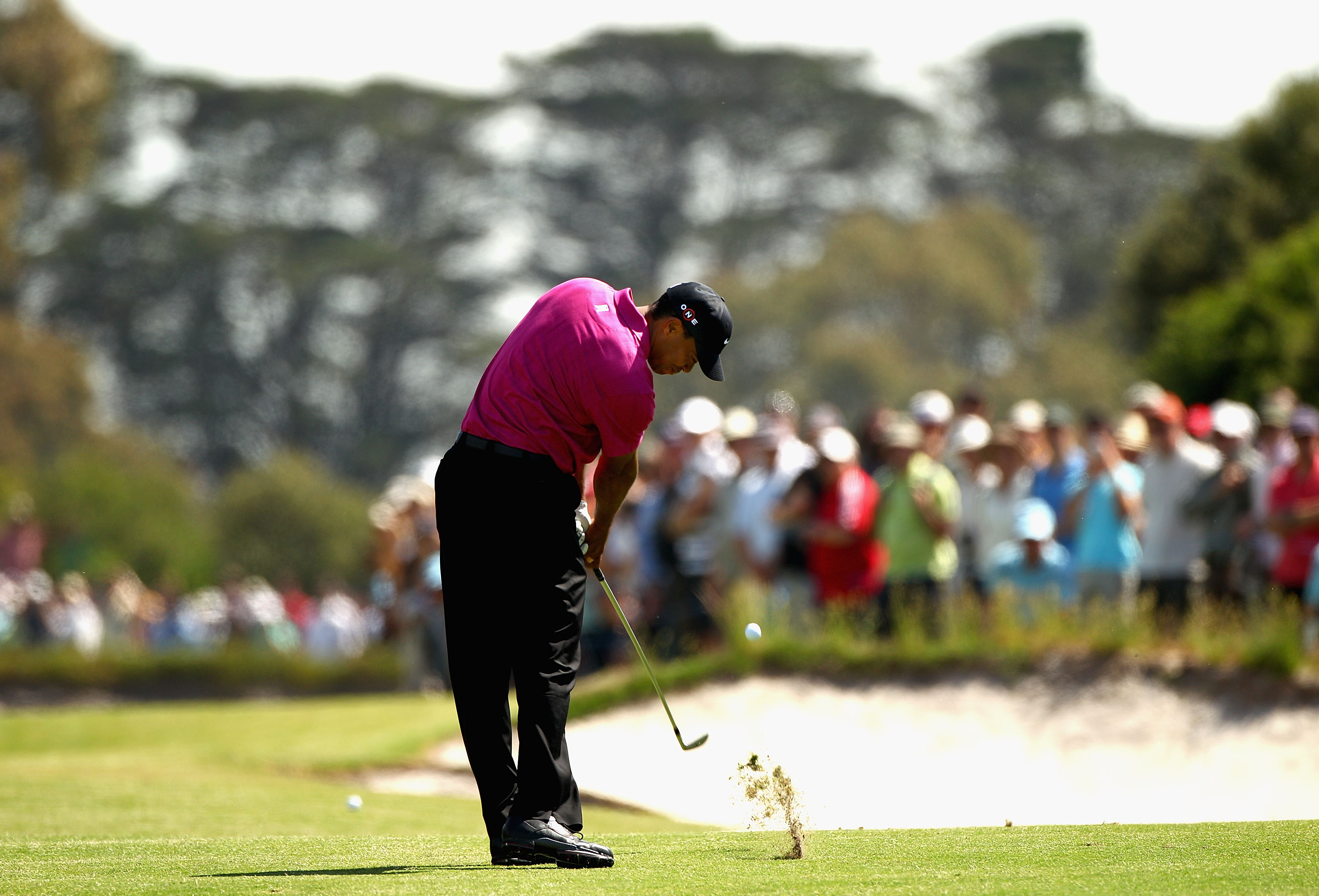 MELBOURNE, AUSTRALIA - NOVEMBER 11:  Tiger Woods of the USA plays an iron shot during day one of the Australian Masters at The Victoria Golf Club on November 11, 2010 in Melbourne, Australia.  (Photo by Ryan Pierse/Getty Images)