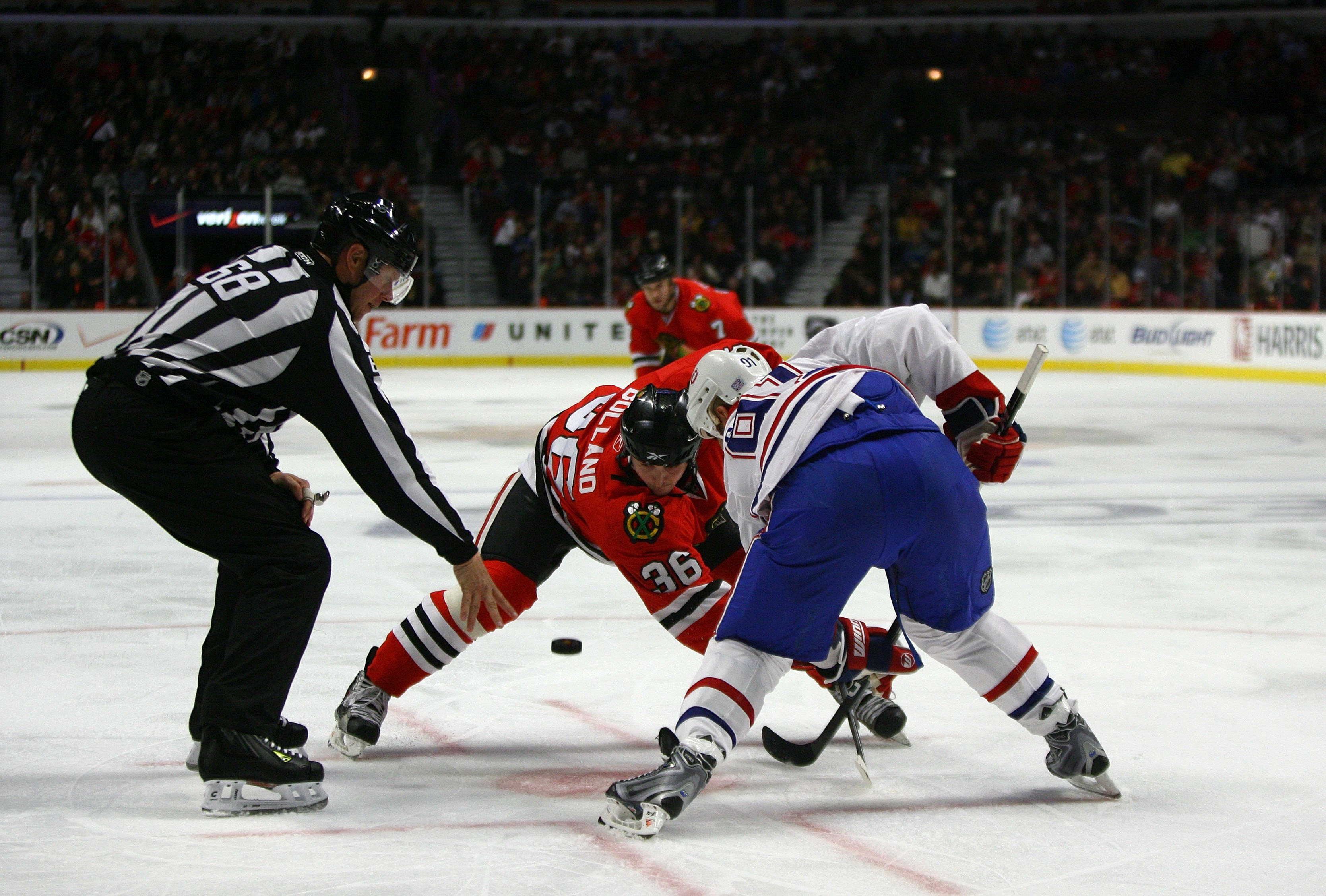 CHICAGO - OCTOBER 30:  Dave Bolland #36 of the Chicago Blackhawks takes the offensive zone faceoff against Scott Gomez #91 of the Montreal Canadiens during their game at the United Center on October 30, 2009 in Chicago, Illinois. The Blackhawks defeated t