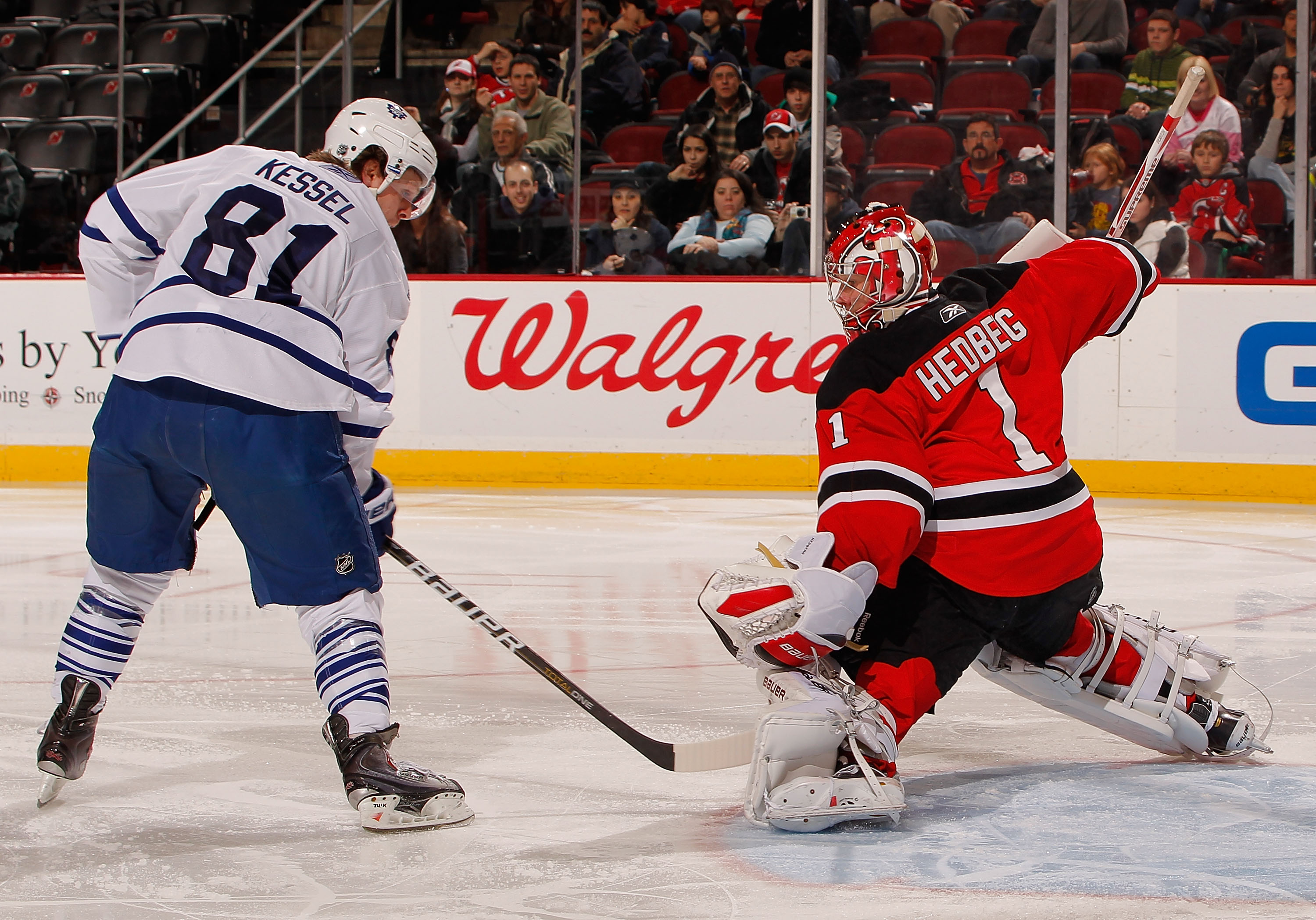 NEWARK, NJ - DECEMBER 26:  Phil Kessel #81 of the Toronto Maple Leafs is stopped on this tip in attempt by Johan Hedberg #1 of the New Jersey Devils in the third period of an NHL hockey game at the Prudential Center on December 26, 2010 in Newark, New Jer