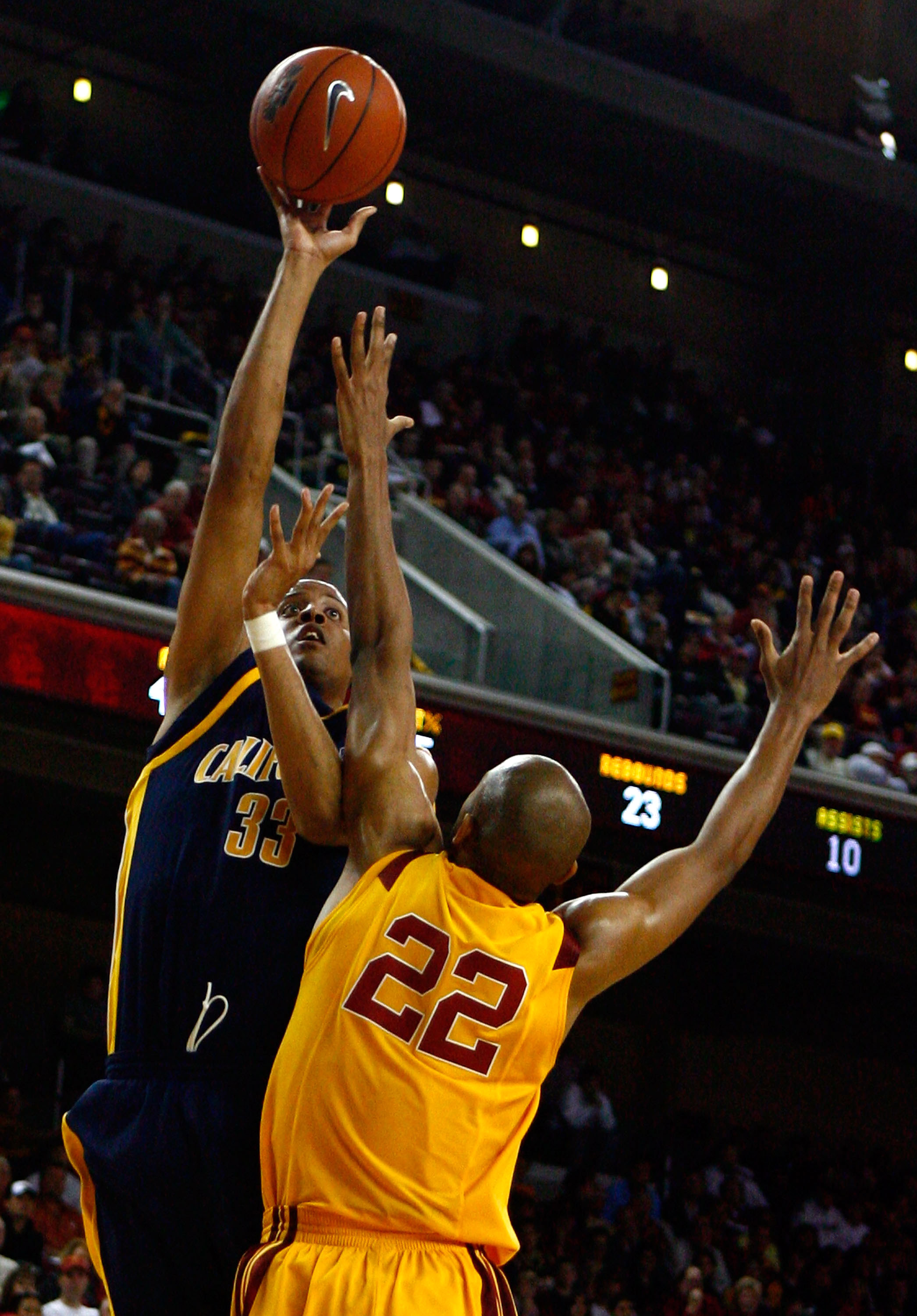 LOS ANGELES, CA - JANUARY 31:  Jordan Wilkes #33 of the Cal Golden Bears shoots over Taj Gibson #22 of the USC Trojans during the second half at the Galen Center on January 31, 2009 in Los Angeles, California. USC defeated Cal 73-62.  (Photo by Jeff Gross