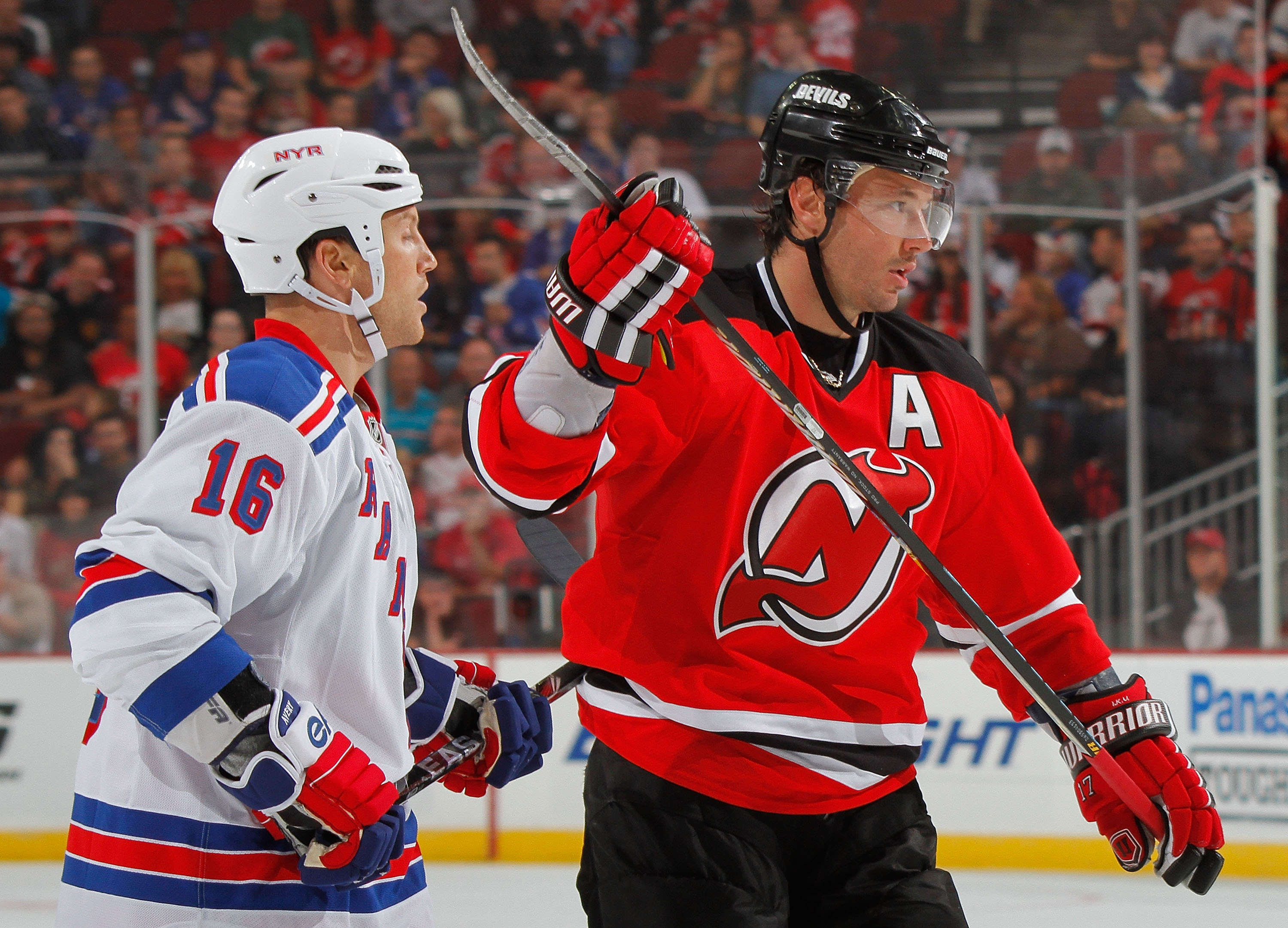 NEWARK, NJ - SEPTEMBER 25:  Sean Avery #16 of the New York Rangers covers Ilya Kovalchuk #17 of the New Jersey Devils during a preseason hockey game at the Prudential Center on September 25, 2010 in Newark, New Jersey.  (Photo by Paul Bereswill/Getty Imag