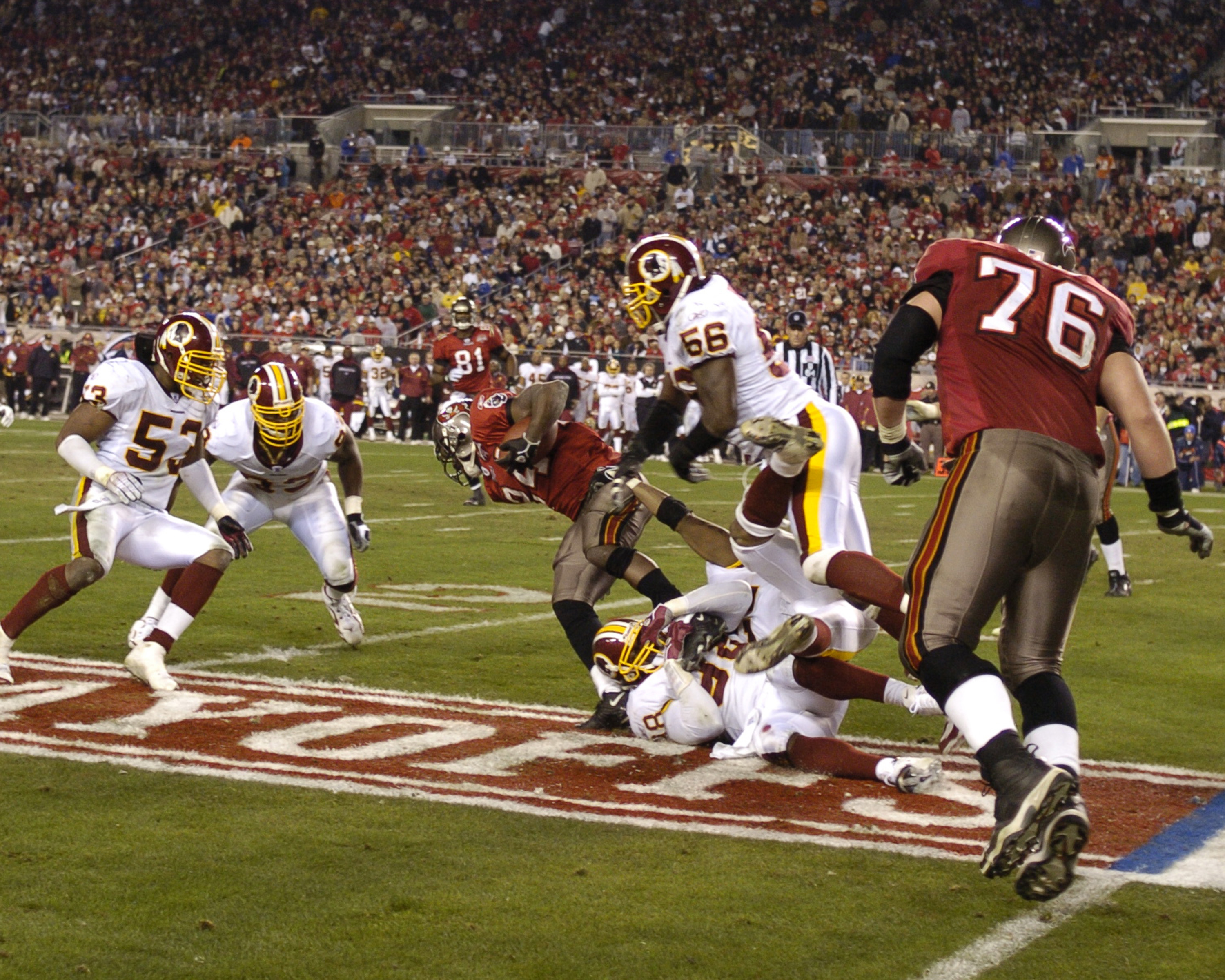 1c51fac2 Tampa Bay Buccaneers running back Carnell Williams weaves upfield for a  gain against the Washington Redskins