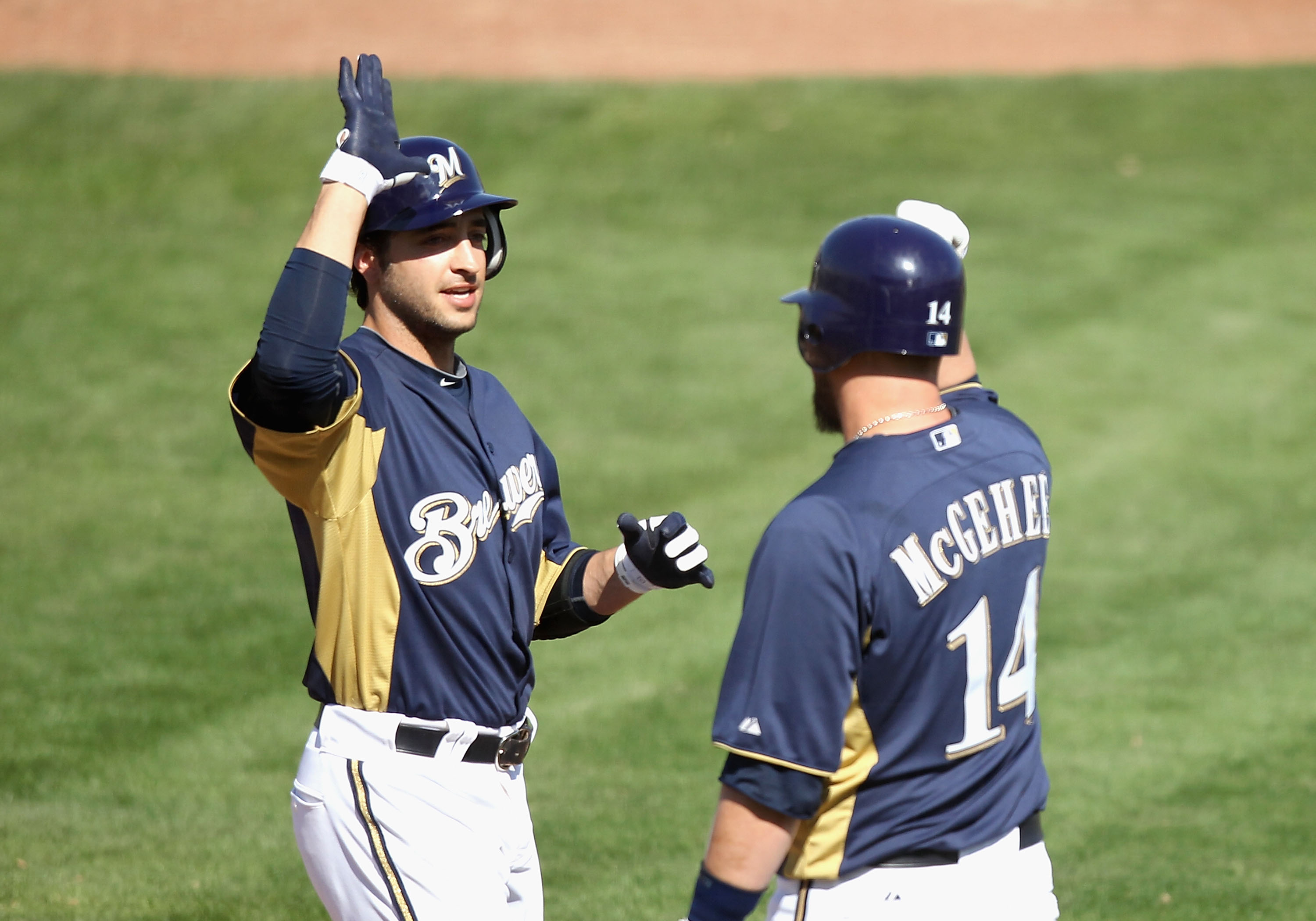 PHOENIX, AZ - MARCH 03:  Ryan Braun #8 of the Milwaukee Brewers high fives teammate Casey McGehee #14 after Braun hit a 2 run home run against the Oakland Athletics during the third inning of the spring training game at Maryvale Baseball Park on March 3,