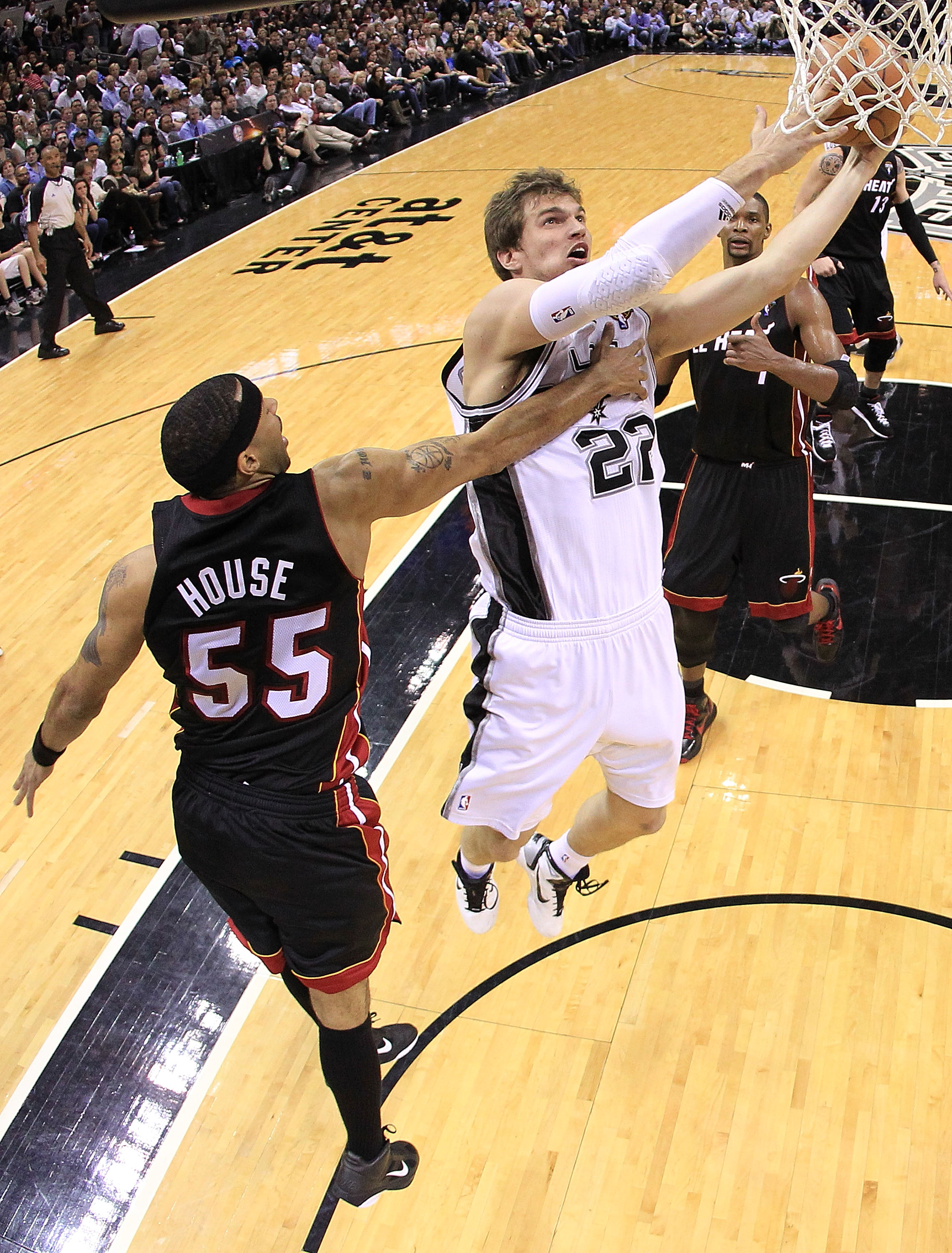 SAN ANTONIO, TX - MARCH 04:  Forward Tiago Splitter #22 of the San Antonio Spurs takes a shot against Eddie House #55 of the Miami Heat at AT&T Center on March 4, 2011 in San Antonio, Texas.   NOTE TO USER: User expressly acknowledges and agrees that, by