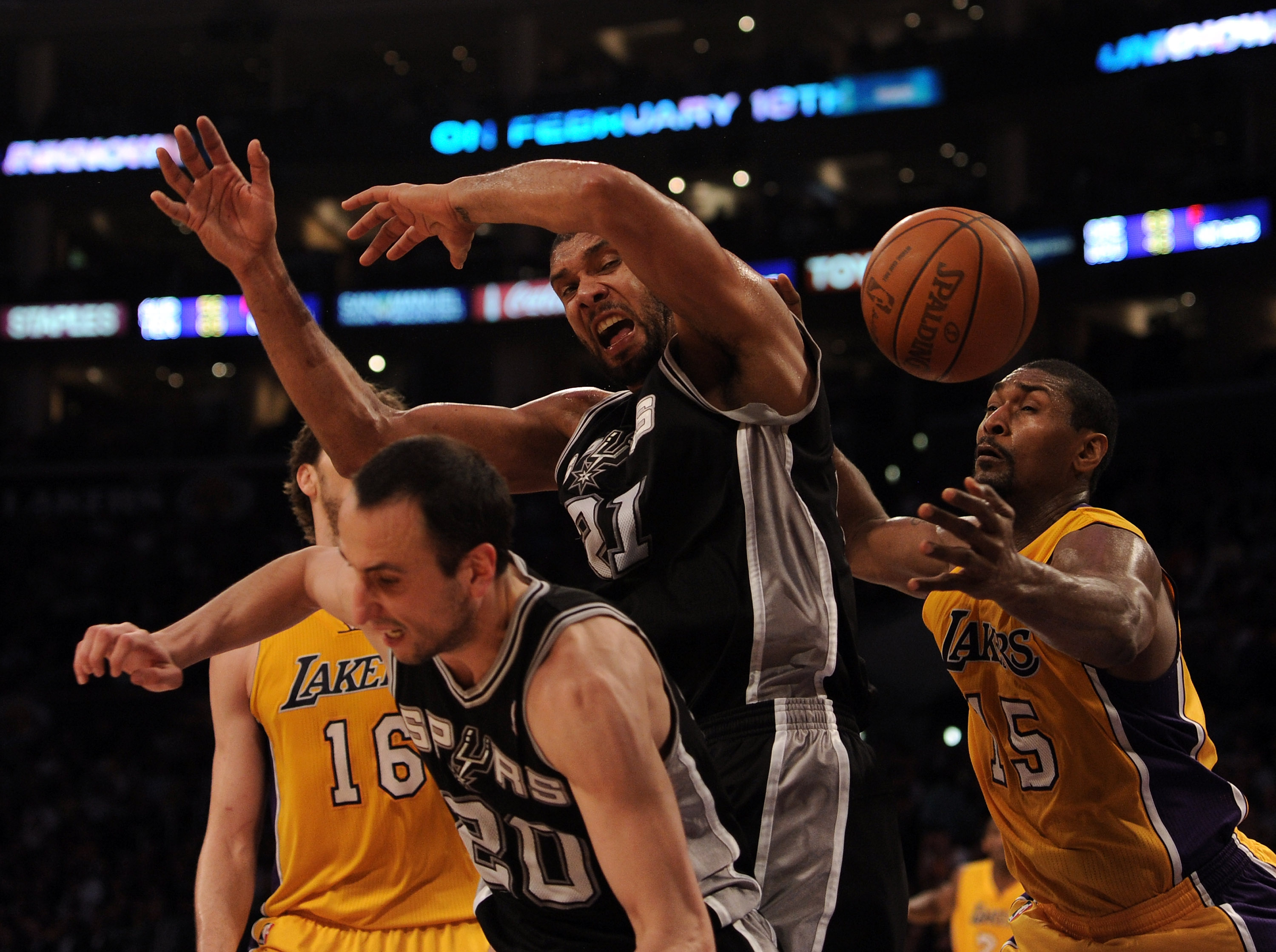 LOS ANGELES, CA - FEBRUARY 03:  Tim Duncan #21 of the San Antonio Spurs has the ball knocked away by Ron Artest #15 of the Los Angeles Lakers as Manu Ginobili #20 and Pau Gasol #16 look for a rebound during the first half at Staples Center on February 3,