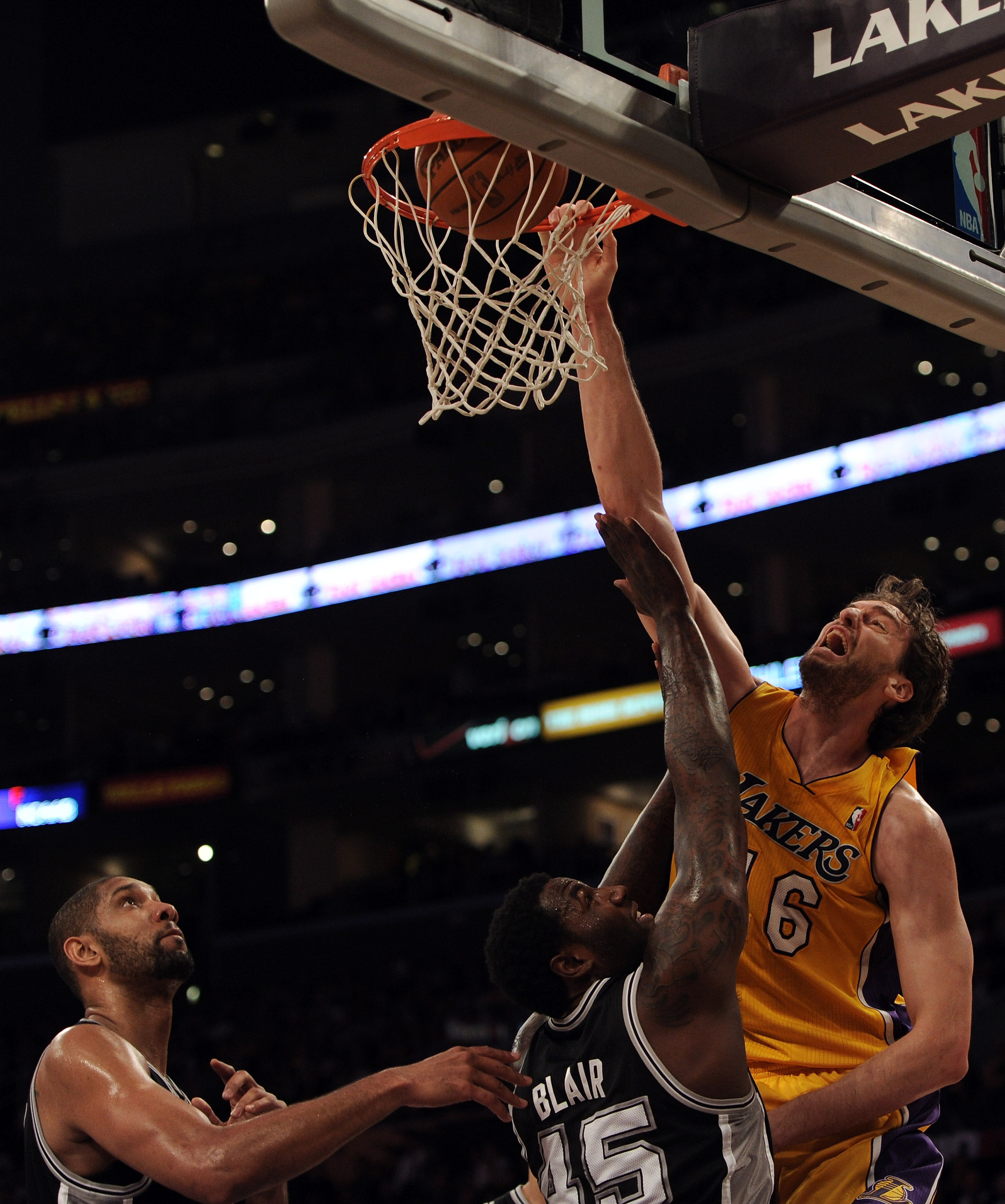 LOS ANGELES, CA - FEBRUARY 03:  Pau Gasol #16 of the Los Angeles Lakers dunks in front of DeJuan Blair #45 and Tim Duncan #21 of the San Antonio Spurs at Staples Center on February 3, 2011 in Los Angeles, California.  NOTE TO USER: User expressly acknowle