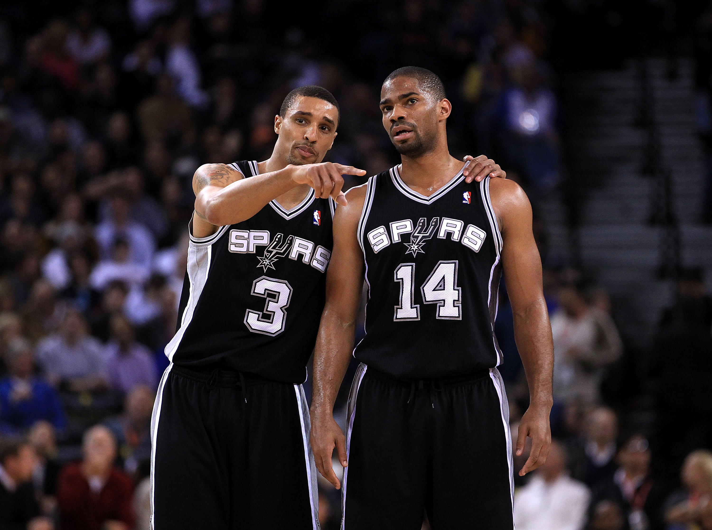 OAKLAND, CA - JANUARY 24:  George Hill #3 talks to Gary Neal #14 of the San Antonio Spurs during their game against the Golden State Warriors at Oracle Arena on January 24, 2011 in Oakland, California.  NOTE TO USER: User expressly acknowledges and agrees
