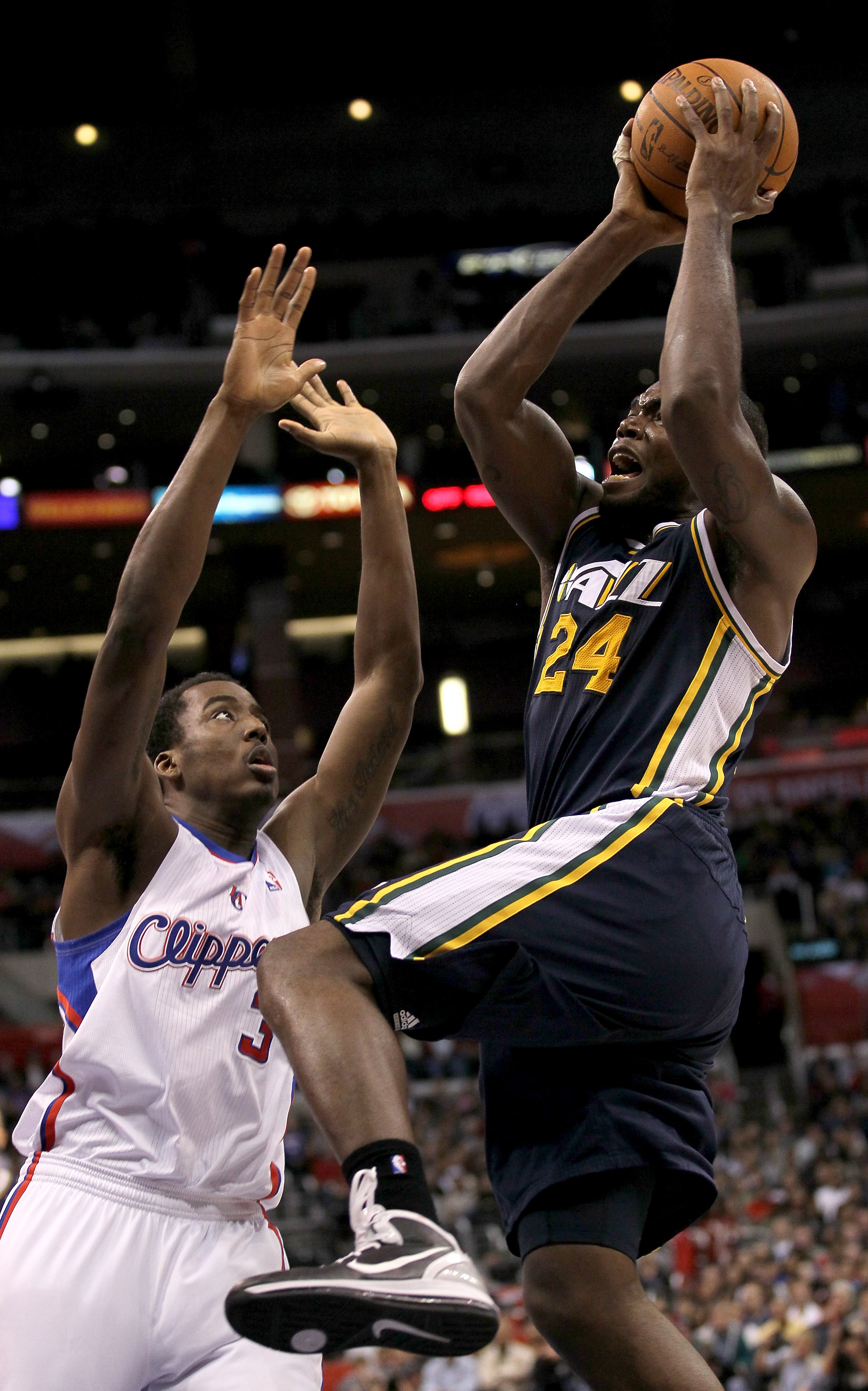 LOS ANGELES, CA - DECEMBER 29:  Paul Millsap #24 of the Utah Jazz shoots over Al-Farouq Aminu #3 of the Los Angeles Clippers at Staples Center on December 29, 2010 in Los Angeles, California.   The Jazz won 103-85.  NOTE TO USER: User expressly acknowledg
