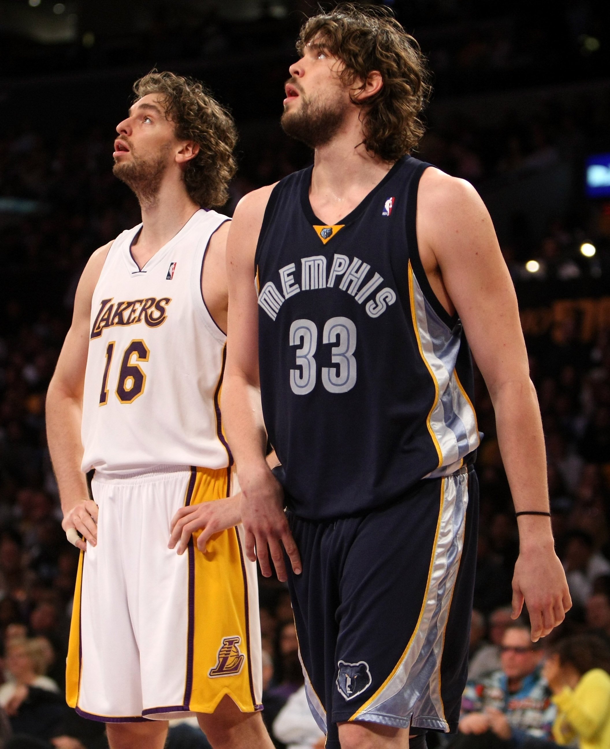 LOS ANGELES, CA - APRIL 12:  Marc Gasol #33 of the Memphis Grizzlies and Pau Gasol #16 of the Los Angeles Lakers wait for the play under the basket on April 12, 2009 at Staples Center in Los Angeles, California. NOTE TO USER: User expressly acknowledges a