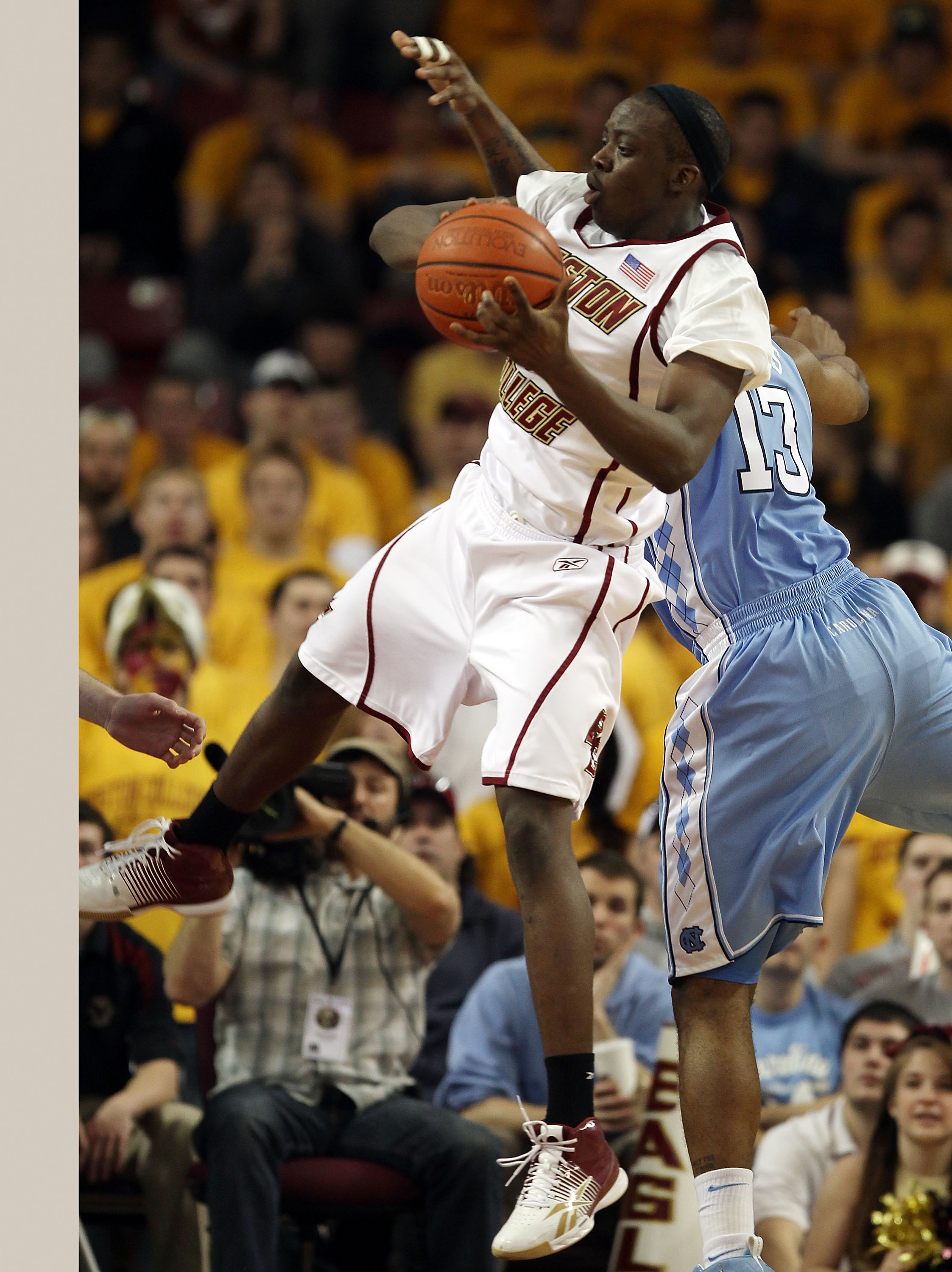 CHESTNUT HILL, MA - FEBRUARY 20:  Reggie Jackson #0 of the Boston College Eagles goes up for two as Will Graves #13  the North Carolina Tar Heels defends on February 20, 2010 at Conte Forum in Chestnut Hill, Massachusetts. The Eagles defeated the Tar Heel