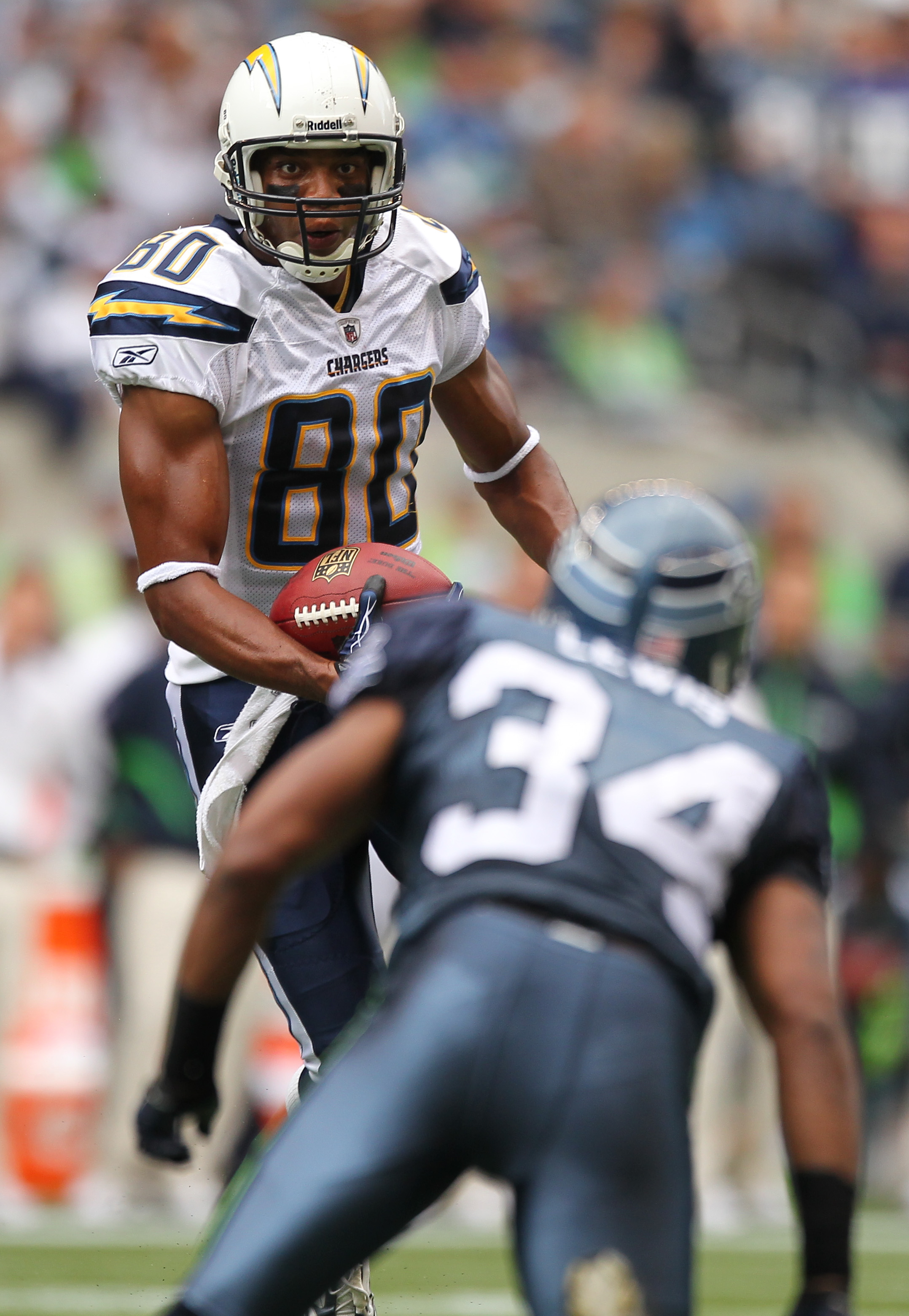 SEATTLE - SEPTEMBER 26:  Wide receiver Malcom Floyd #80 of the San Diego Chargers rushes against Roy Lewis #34 of the Seattle Seahawks at Qwest Field on September 26, 2010 in Seattle, Washington. (Photo by Otto Greule Jr/Getty Images)