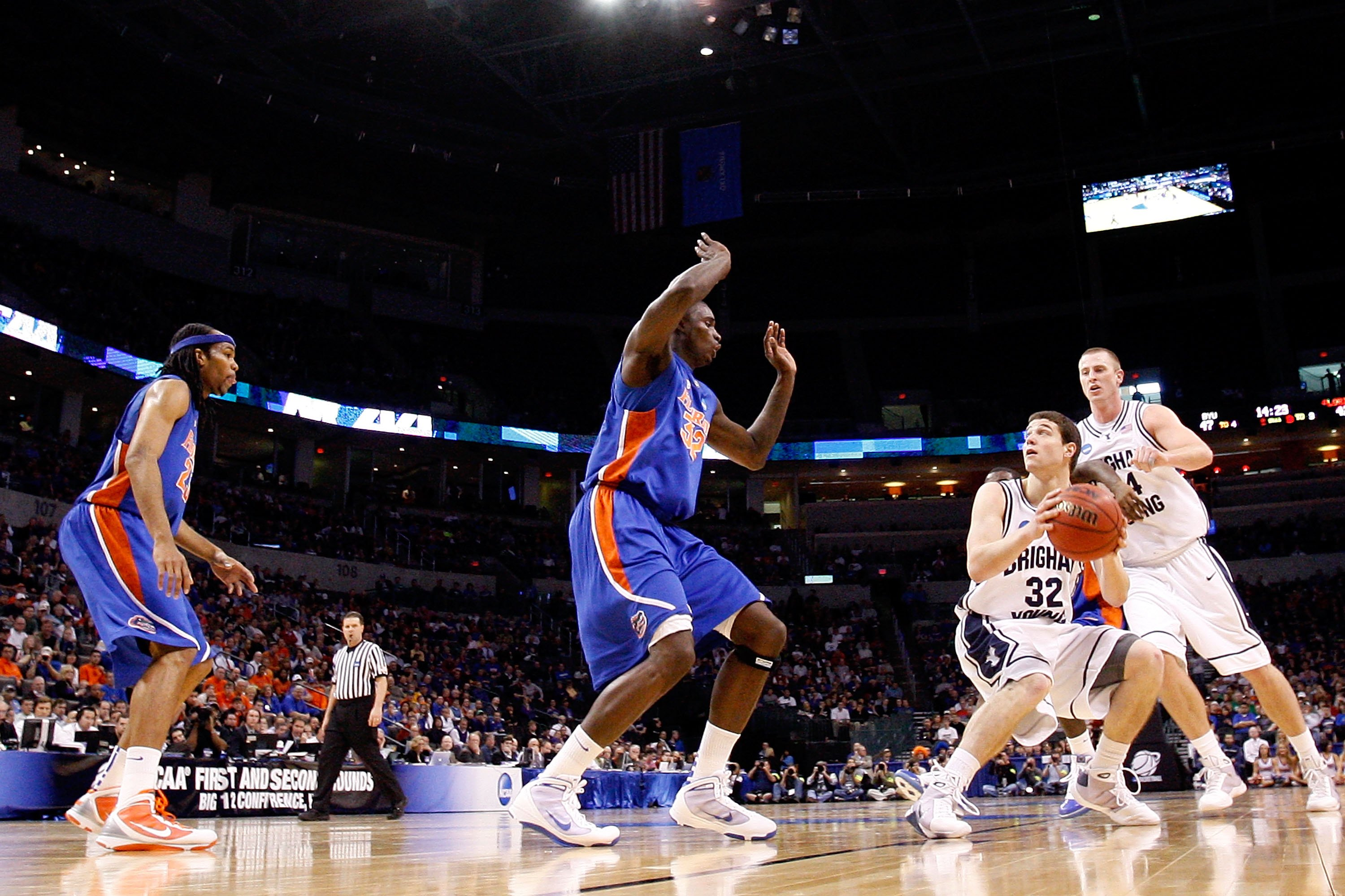 OKLAHOMA CITY - MARCH 18:  Jimmer Fredette #32 of the BYU Cougars looks to shoot the ball against Vernon Macklin #32 of the Florida Gators during the first round of the 2010 NCAA men�s basketball tournament at Ford Center on March 18, 2010 in Oklahoma Cit