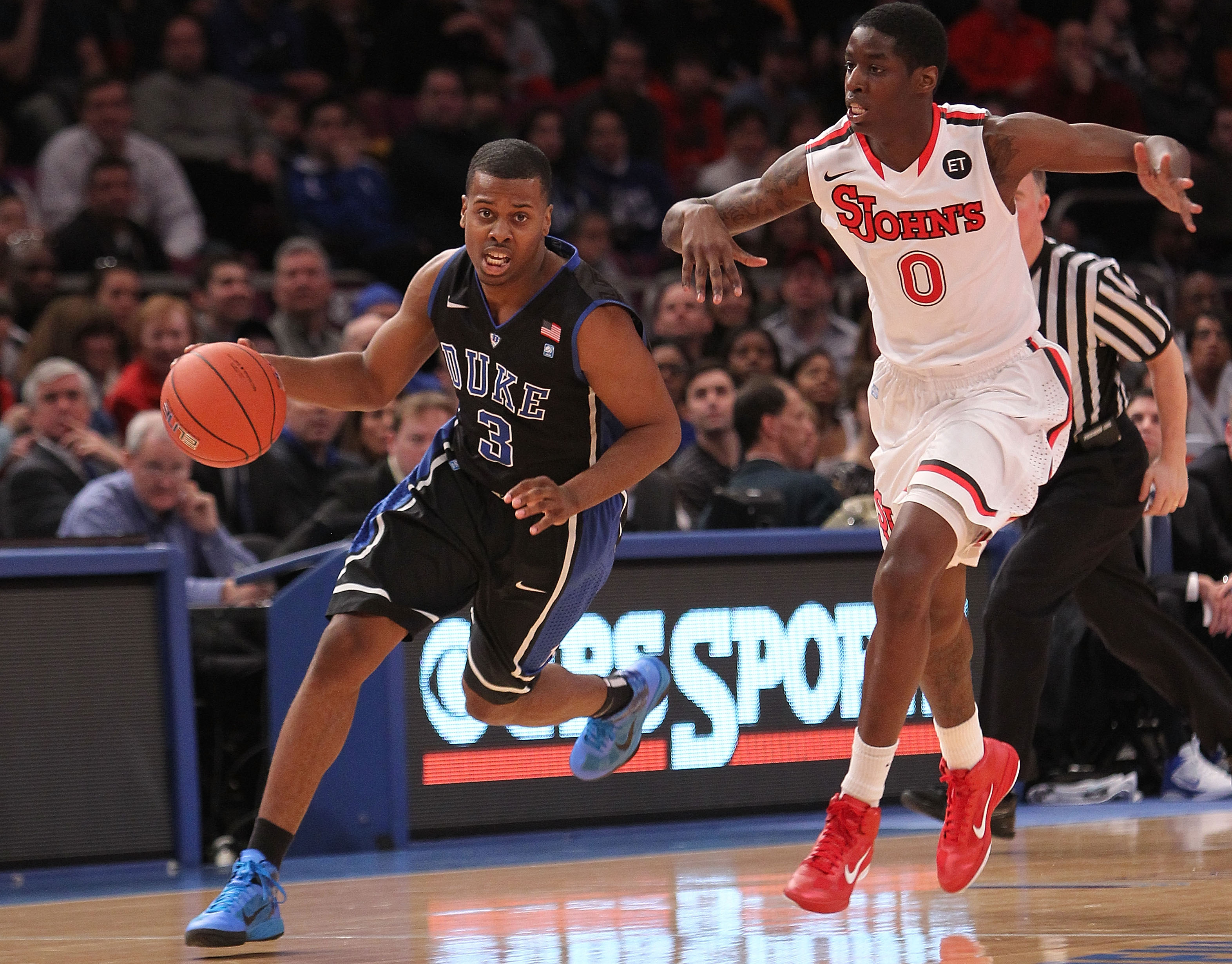 NEW YORK, NY - JANUARY 30:  Tyler Thornton #3 of the Duke Blue Devils dribbles the ball against Dwayne Polee II #0 of the St. John's Red Storm at Madison Square Garden on January 30, 2011 in New York City.  (Photo by Nick Laham/Getty Images)