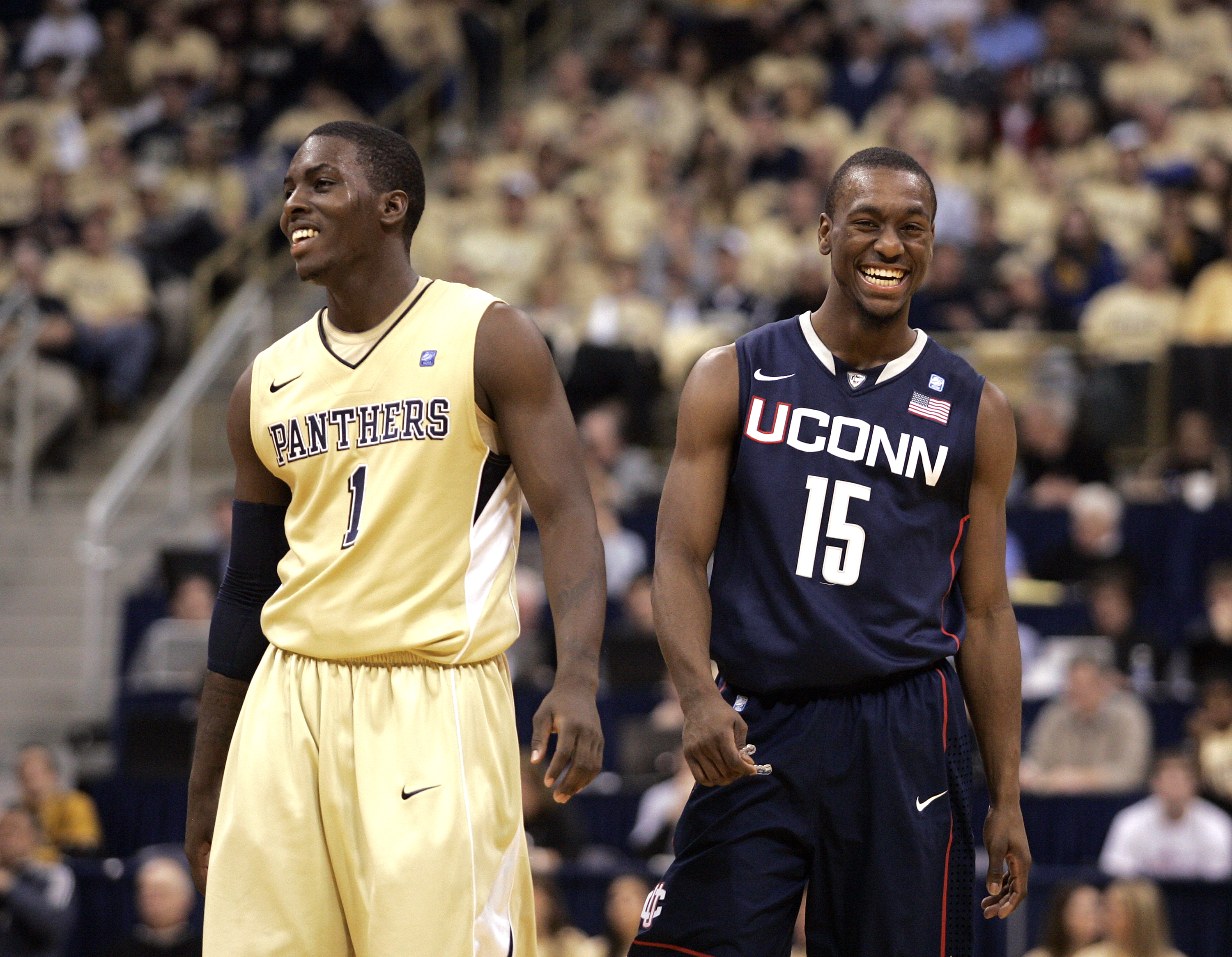 PITTSBURGH, PA - DECEMBER 27:  Travon Woodall #1 of the Pittsburgh Panthers and Kemba Walker #15 of the Connecticut Huskies have a laugh at Petersen Events Center on December 27, 2010 in Pittsburgh, Pennsylvania.  Pittsburgh defeated Connecticut 78-64.  (