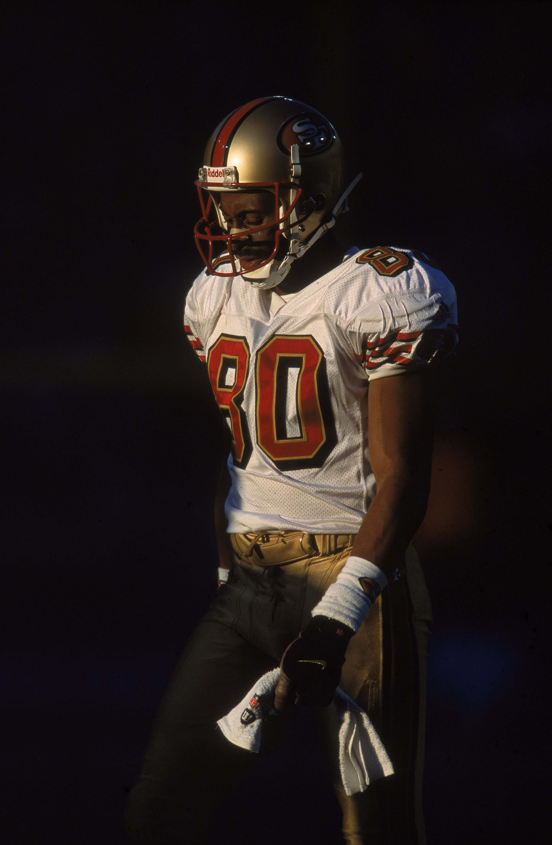 23 Dec 2000:  Jerry Rice #80 of the San Francisco 49ers walks and looks down during the game against the Denver Broncos at the Mile High Stadium in Denver, Colorado. The Broncos defeated the 49ers 38-9.Mandatory Credit: Brian Bahr  /Allsport