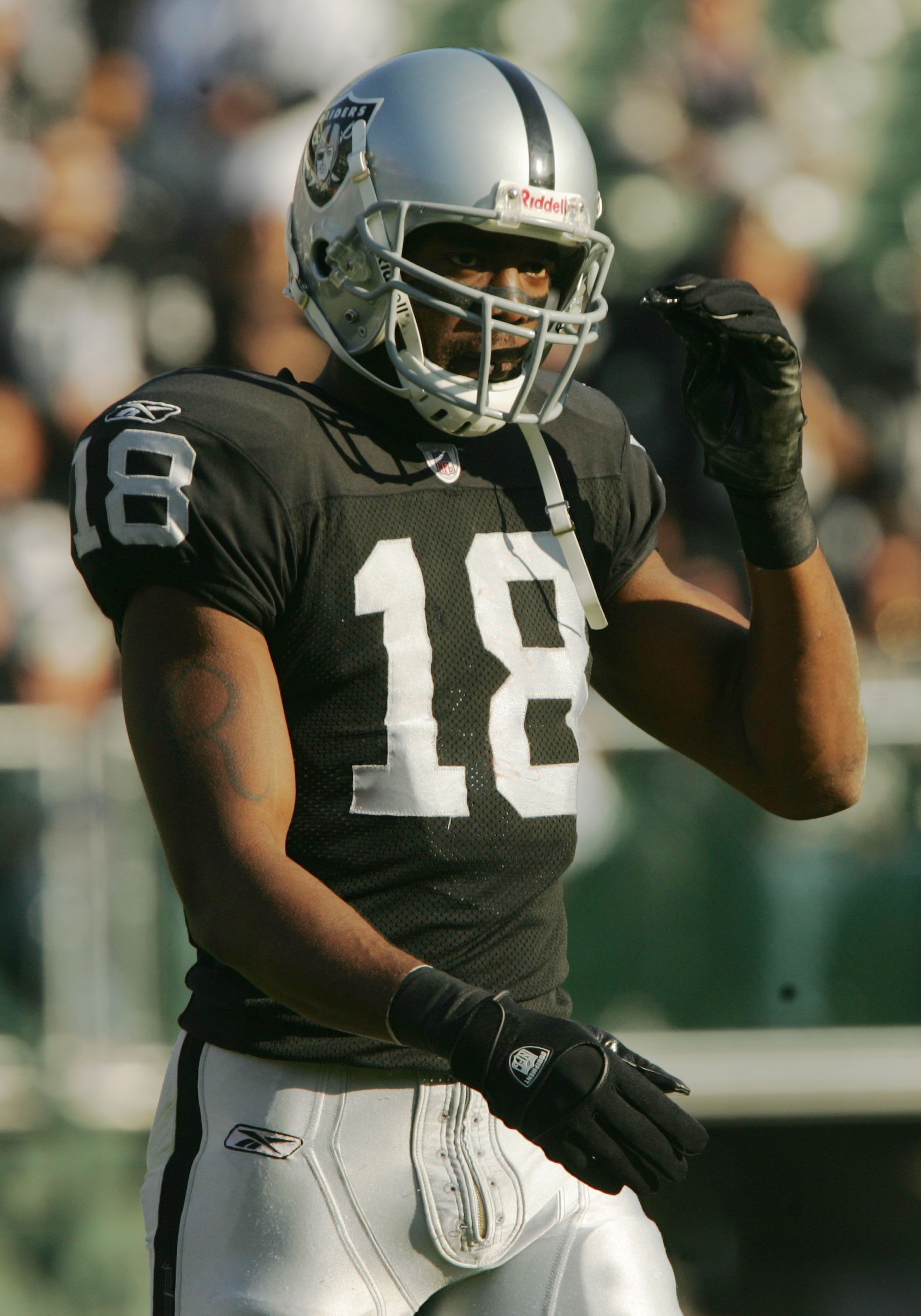 OAKLAND, CA - DECEMBER 3:  Randy Moss #18 of the Oakland Raiders reacts after a play against the Houston Texans during an NFL game at McAfee Coliseum December 3, 2006 in Oakland, California.  (Photo by Stephen Dunn/Getty Images)