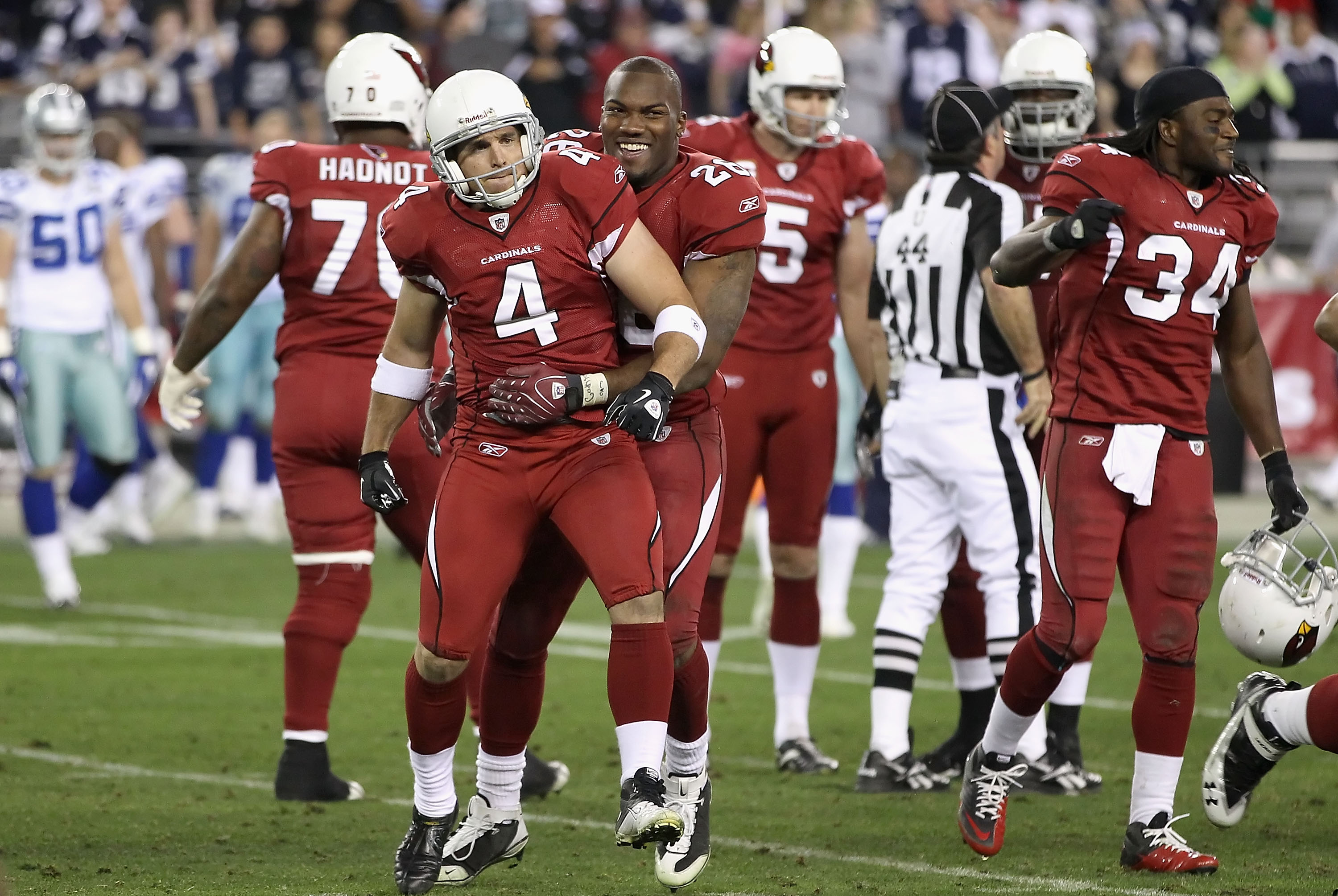 GLENDALE, AZ - DECEMBER 25:  Kicker Jay Feely #4 of the Arizona Cardinals celebrates with Beanie Wells #26 after making a 48 yard field goal in the final moments of the NFL game against the Dallas Cowboys at the University of Phoenix Stadium on December 2
