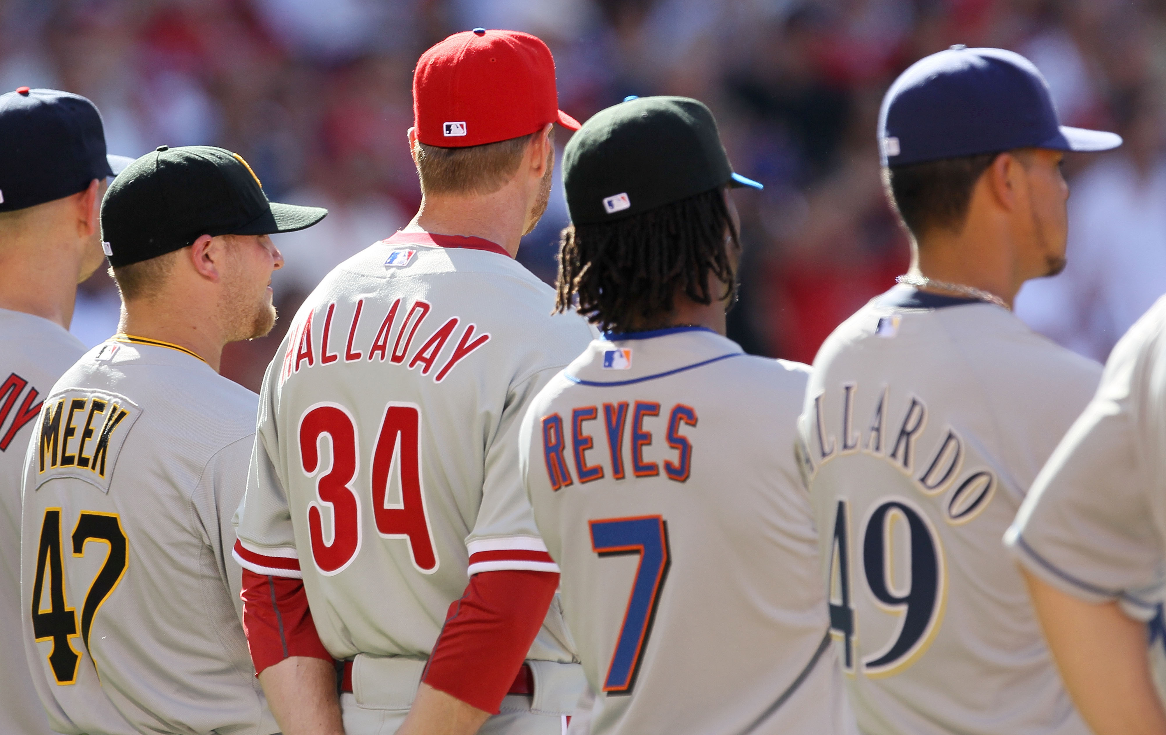 ANAHEIM, CA - JULY 13:  (L) National League All-Star pitcher Evan Meek stands with his teammates prior to the 81st MLB All-Star Game at Angel Stadium of Anaheim on July 13, 2010 in Anaheim, California.  (Photo by Stephen Dunn/Getty Images)
