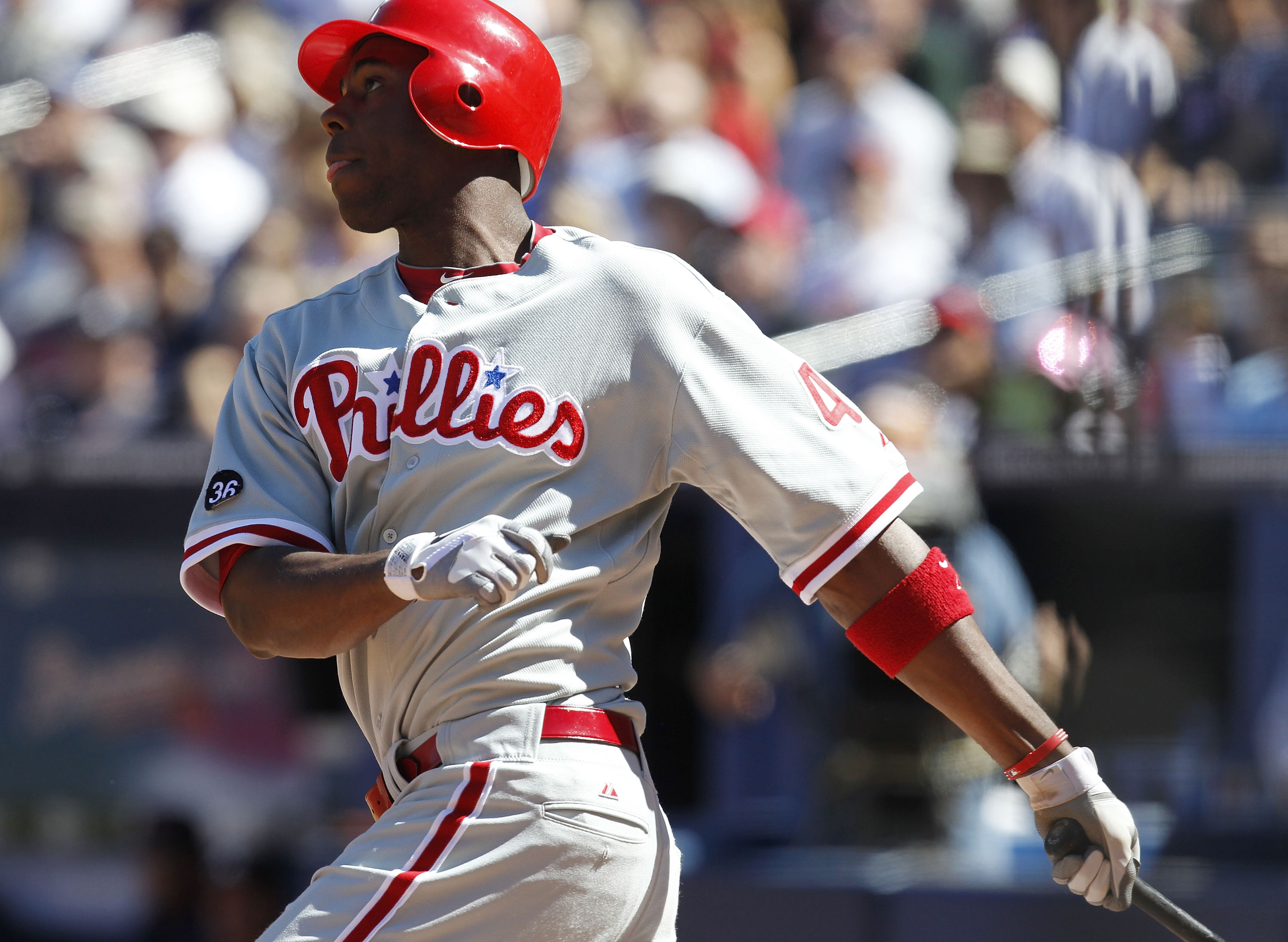 ATLANTA - OCTOBER 3:  Outfielder John Mayberry #40 of the Philadelphia Phillies hits a two run pinch hit home run during the game against the Atlanta Braves at Turner Field on October 3, 2010 in Atlanta, Georgia. The Braves beat the Phillies 8-7.  (Photo