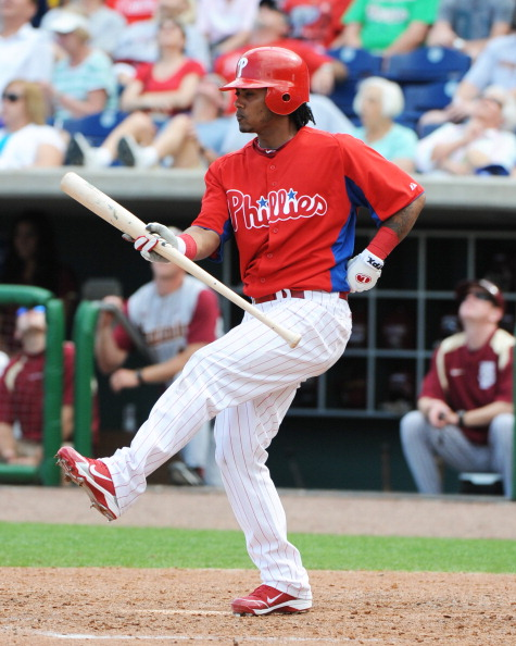 CLEARWATER, FL - FEBRUARY 24:  Infielder Michael Martinez #19 of the Philadelphia Phillies swings against the Florida State Seminoles February 24, 2011 at Bright House Field in Clearwater, Florida.  (Photo by Al Messerschmidt/Getty Images)