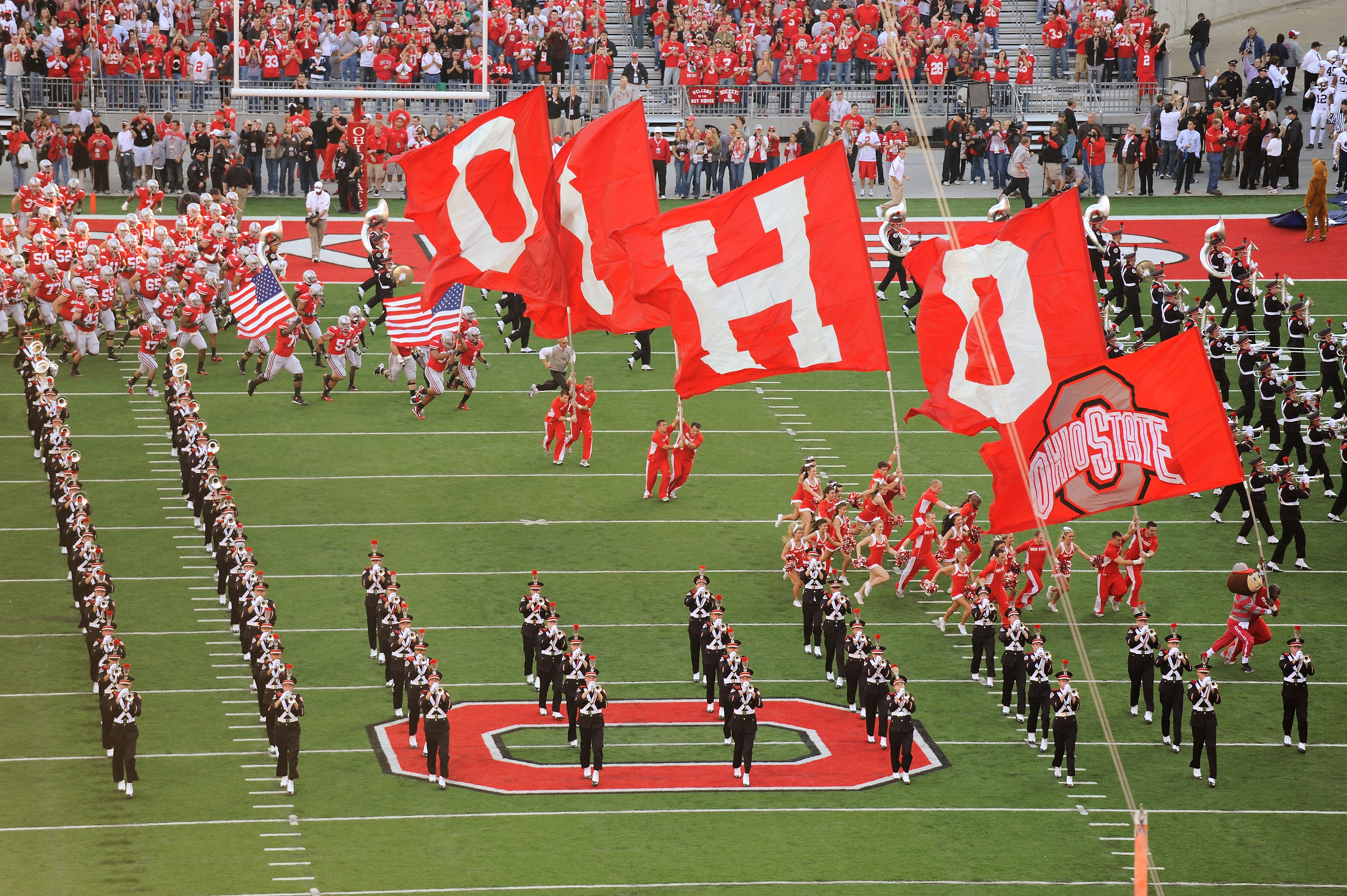 COLUMBUS, OH - NOVEMBER 13:  Bryant Browning #70 of the Ohio State Buckeyes and Cameron Heyward #97 of the Ohio State Buckeyes carry American flags to lead the Buckeyes on to the field before a game against the Penn State Nittany Lions at Ohio Stadium on