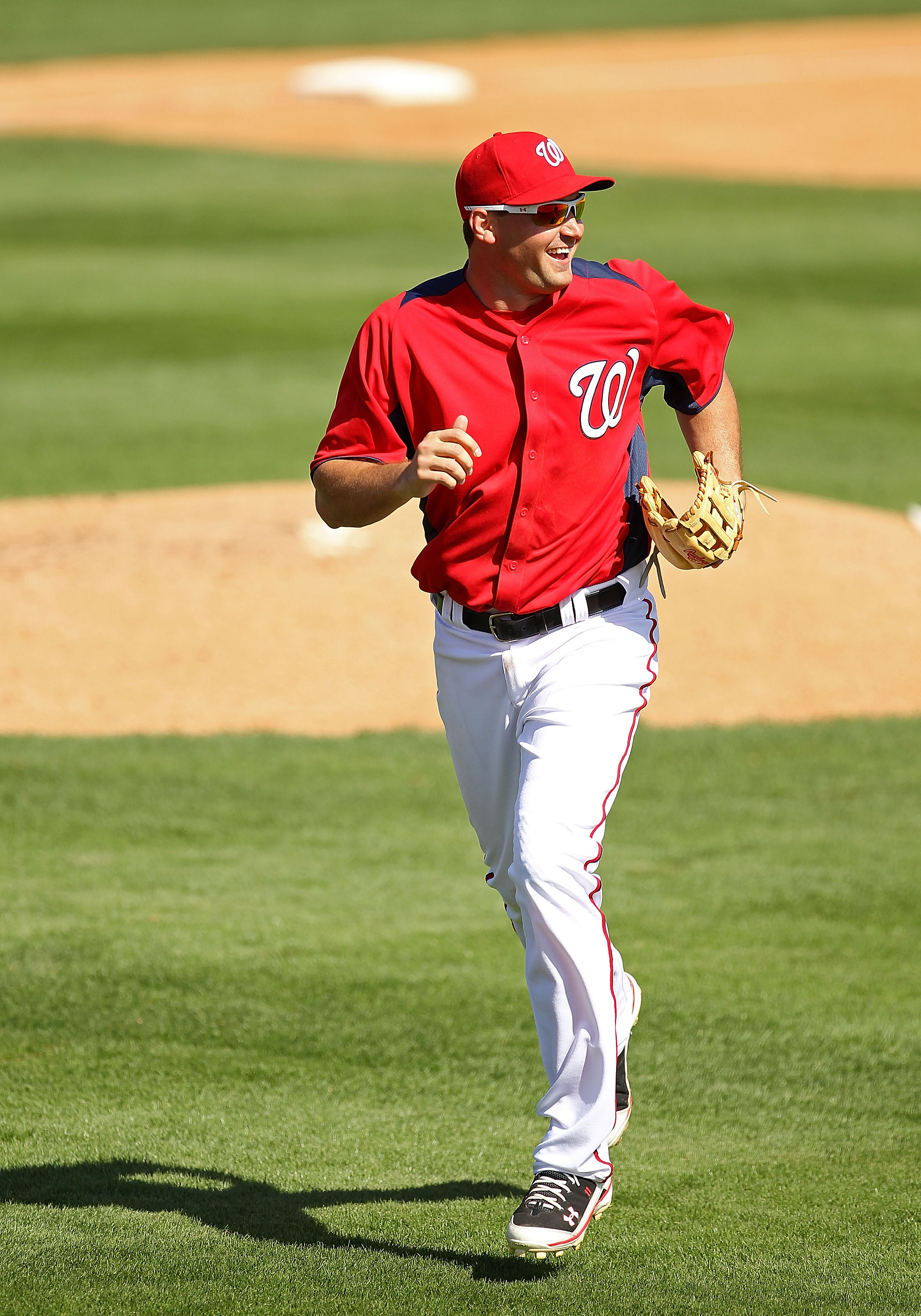 VIERA, FL - MARCH 02:  Ryan Zimmerman #11 of the Washington Nationals jogs back to the dugout during a Spring Training game against the Florida Marlinsat Space Coast Stadium on March 2, 2011 in Viera, Florida.  (Photo by Mike Ehrmann/Getty Images)