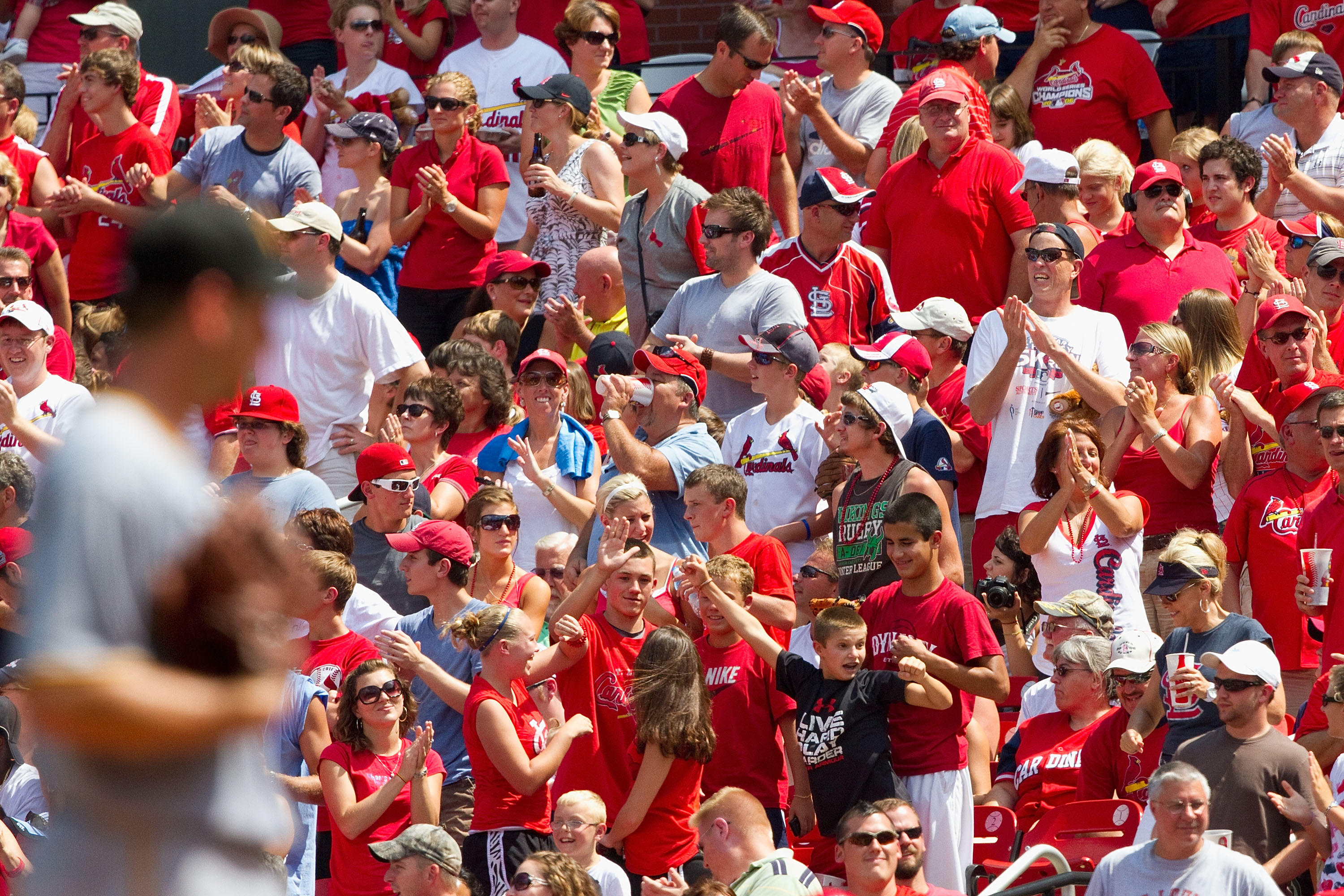 ST. LOUIS - AUGUST 1: St. Louis Cardinals fans react to a home run against the Pittsburgh Pirates at Busch Stadium on August 1, 2010 in St. Louis, Missouri.  The Cardinals beat the Pirates 9-1.  (Photo by Dilip Vishwanat/Getty Images)