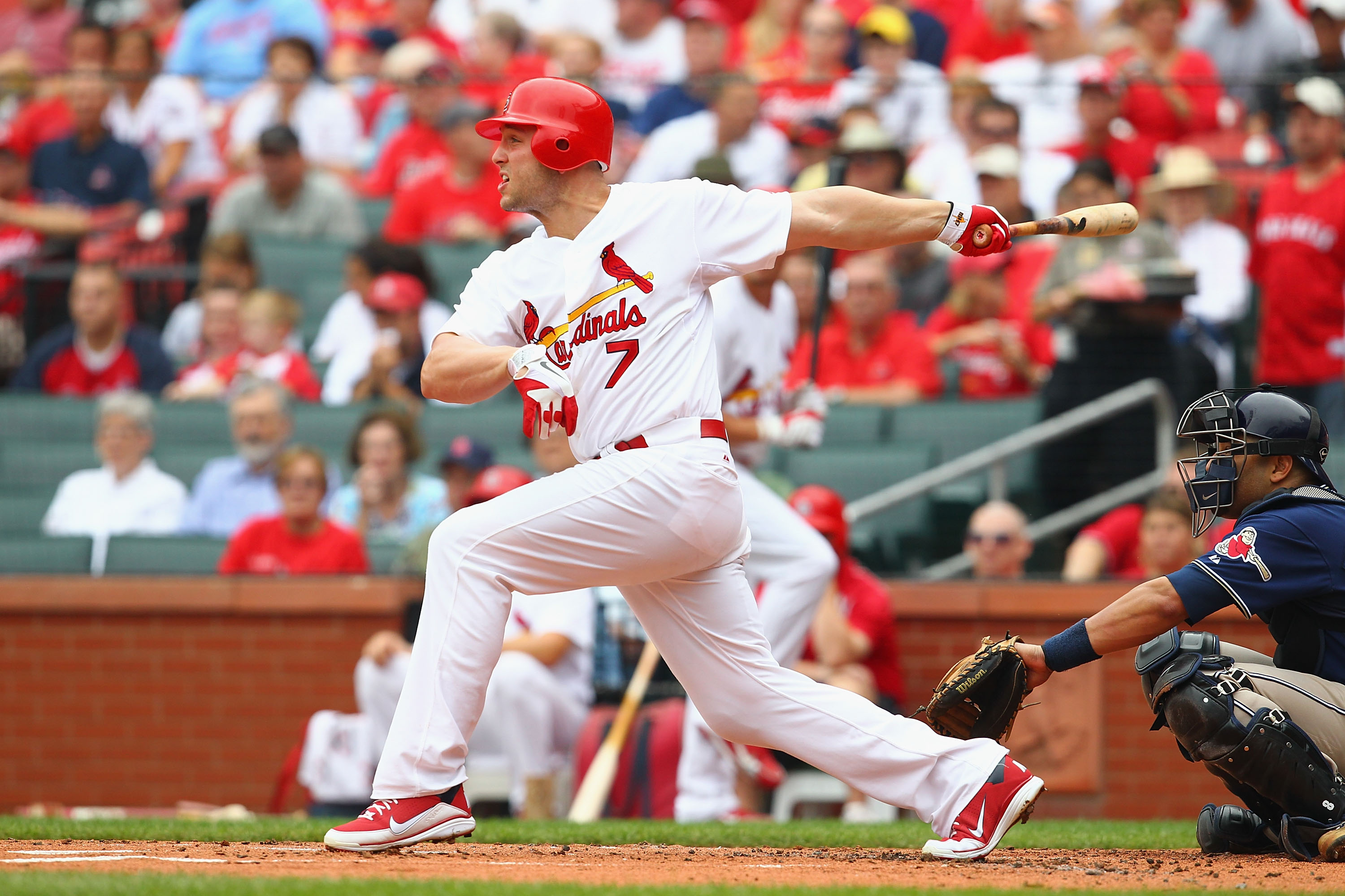 ST. LOUIS - SEPTEMBER 19: Matt Holliday #7 of the St. Louis Cardinals hits an RBI single against the San Diego Padres at Busch Stadium on September 19, 2010 in St. Louis, Missouri.  The Cardinals beat the Padres 4-1.  (Photo by Dilip Vishwanat/Getty Image