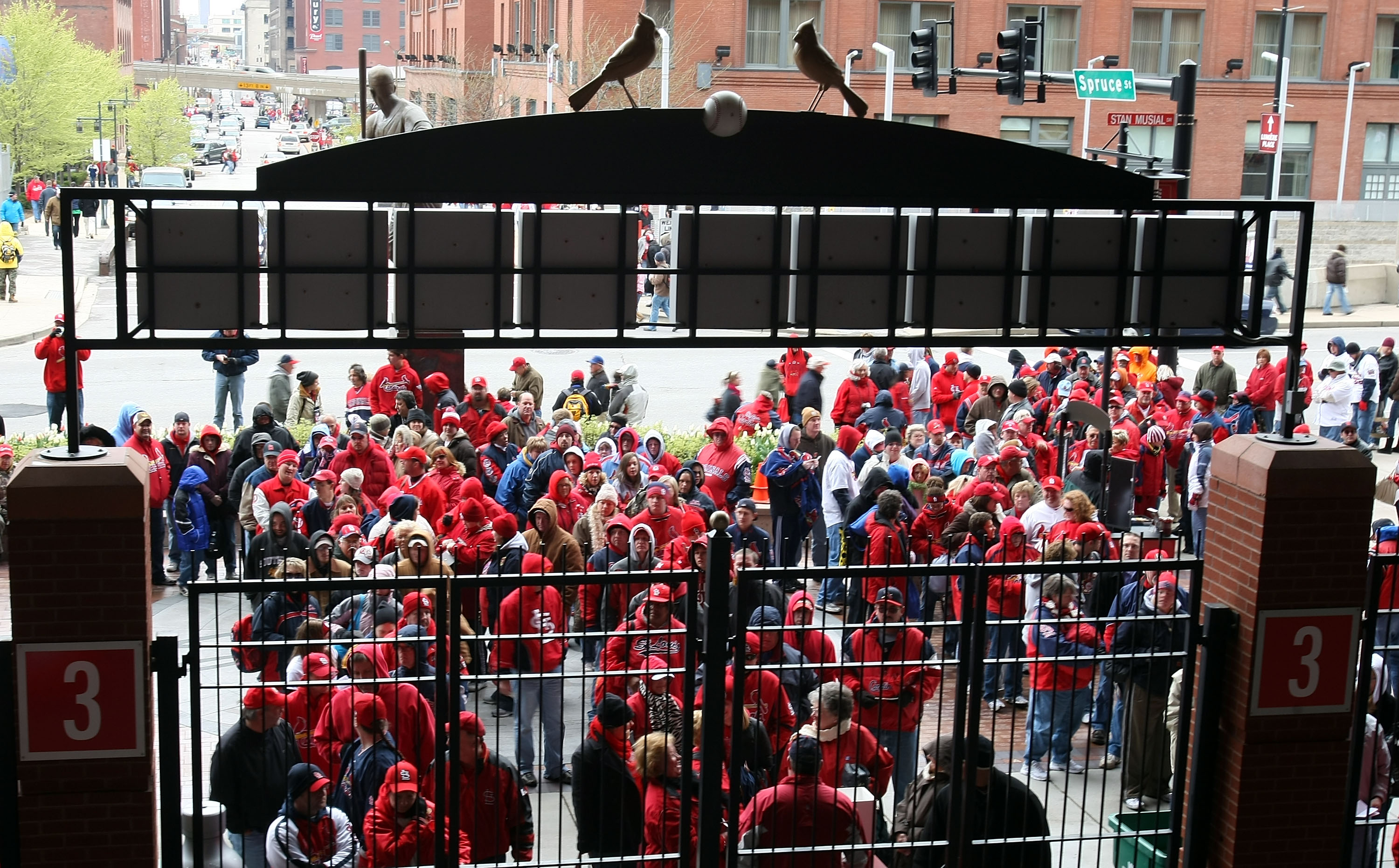 ST. LOUIS - APRIL 06:  Fans wait for the gates to open  for the game between the St. Louis Cardinals and the Pittsburgh Pirates during Opening Day on April 6, 2009  at Busch Stadium in St. Louis, Missouri.  (Photo by Elsa/Getty Images)