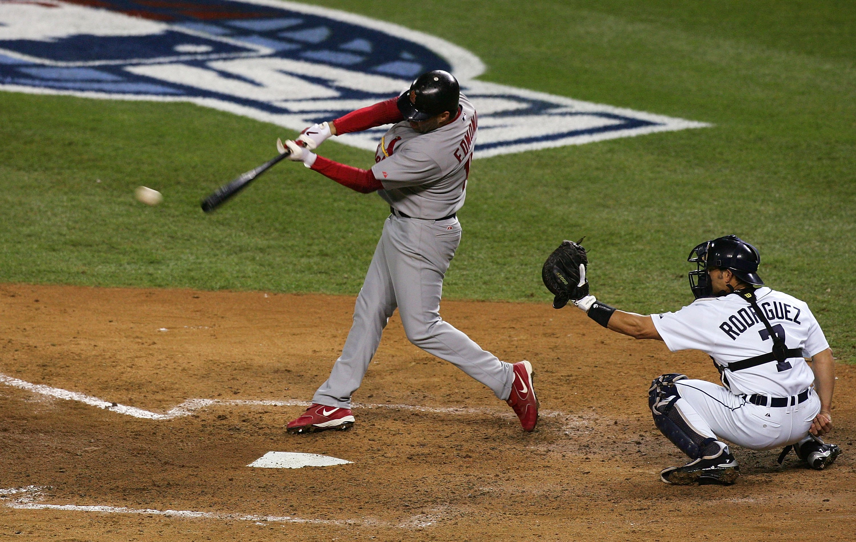 DETROIT - OCTOBER 21:  Jim Edmonds #15 of the St. Louis Cardinals hits an RBI single to score Albert Pujols #5 in the top of the sixth inning against the Detroit Tigers during Game One of 2006 World Series October 21, 2006 at Comerica Park in Detroit Mich