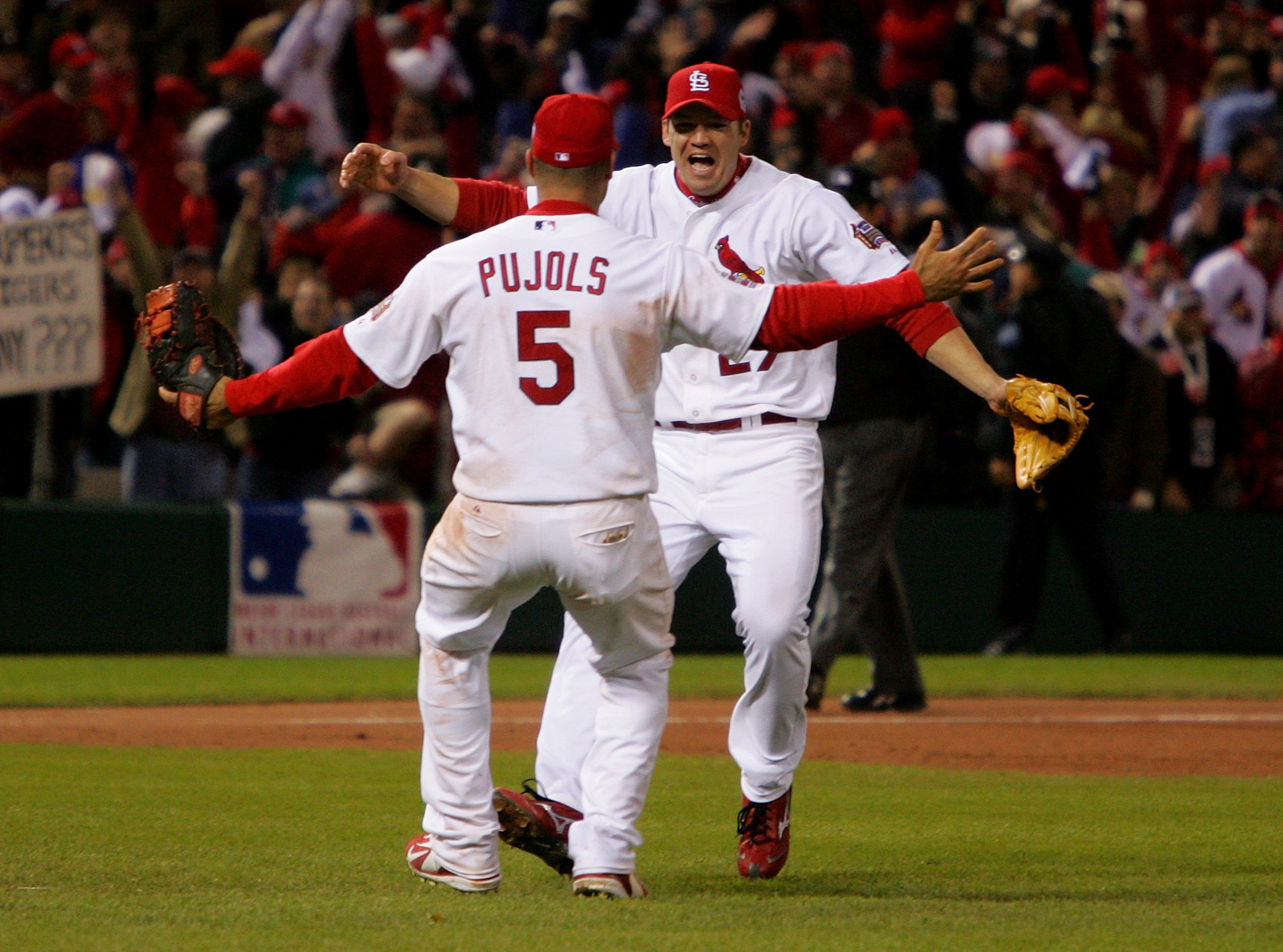 ST LOUIS, MO - OCTOBER 27:  Scott Rolen #27 and Albert Pujols #5 of the St. Louis Cardinals celebrate after defeating the Detroit Tigers in Game Five of the 2006 World Series on October 27, 2006 at Busch Stadium in St. Louis, Missouri.  The Cardinals defe