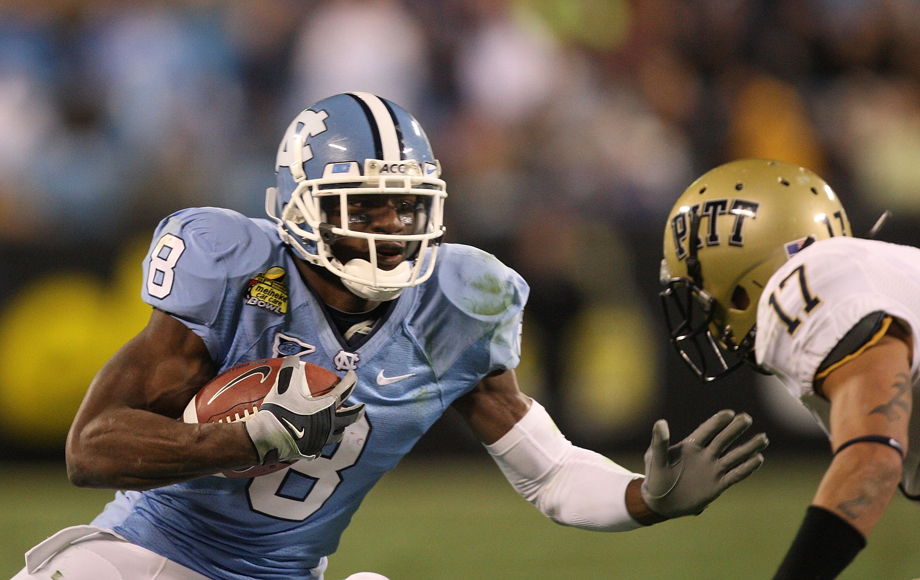 CHARLOTTE, NC - DECEMBER 26:  Aaron Berry #17 of the Pittsburgh Panthers tackles Greg Little #8 of the North Carolina Tar Heels during their game on December 26, 2009 in Charlotte, North Carolina.  (Photo by Streeter Lecka/Getty Images)