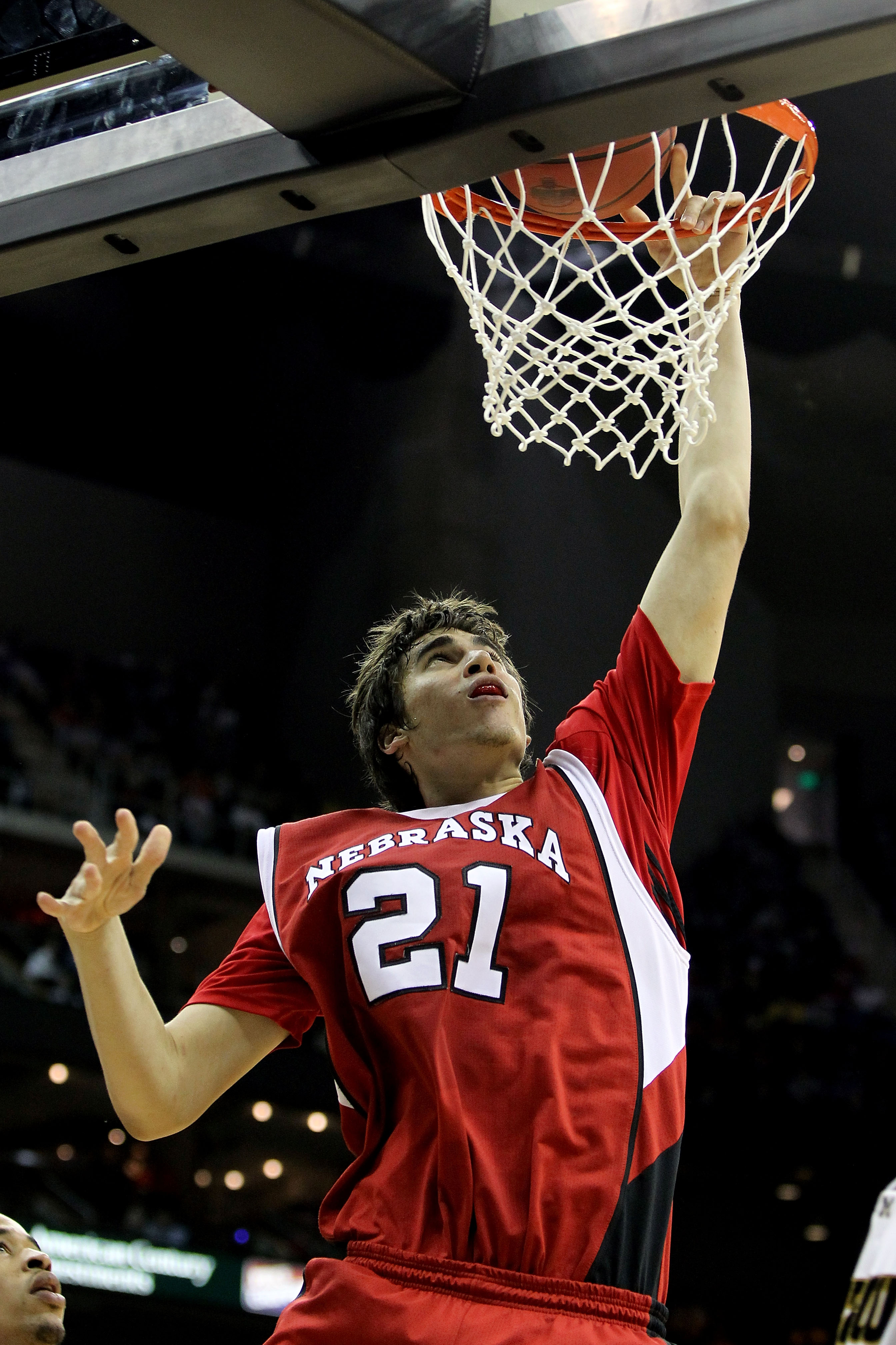 KANSAS CITY, MO - MARCH 10:  Jorge Brian Diaz #21 of the Nebraska Cornhuskers dunks the ball against the Missouri Tigers in the second half during the first round game of the 2010 Phillips 66 Big 12 Men's Basketball Tournament at the Sprint Center on Marc