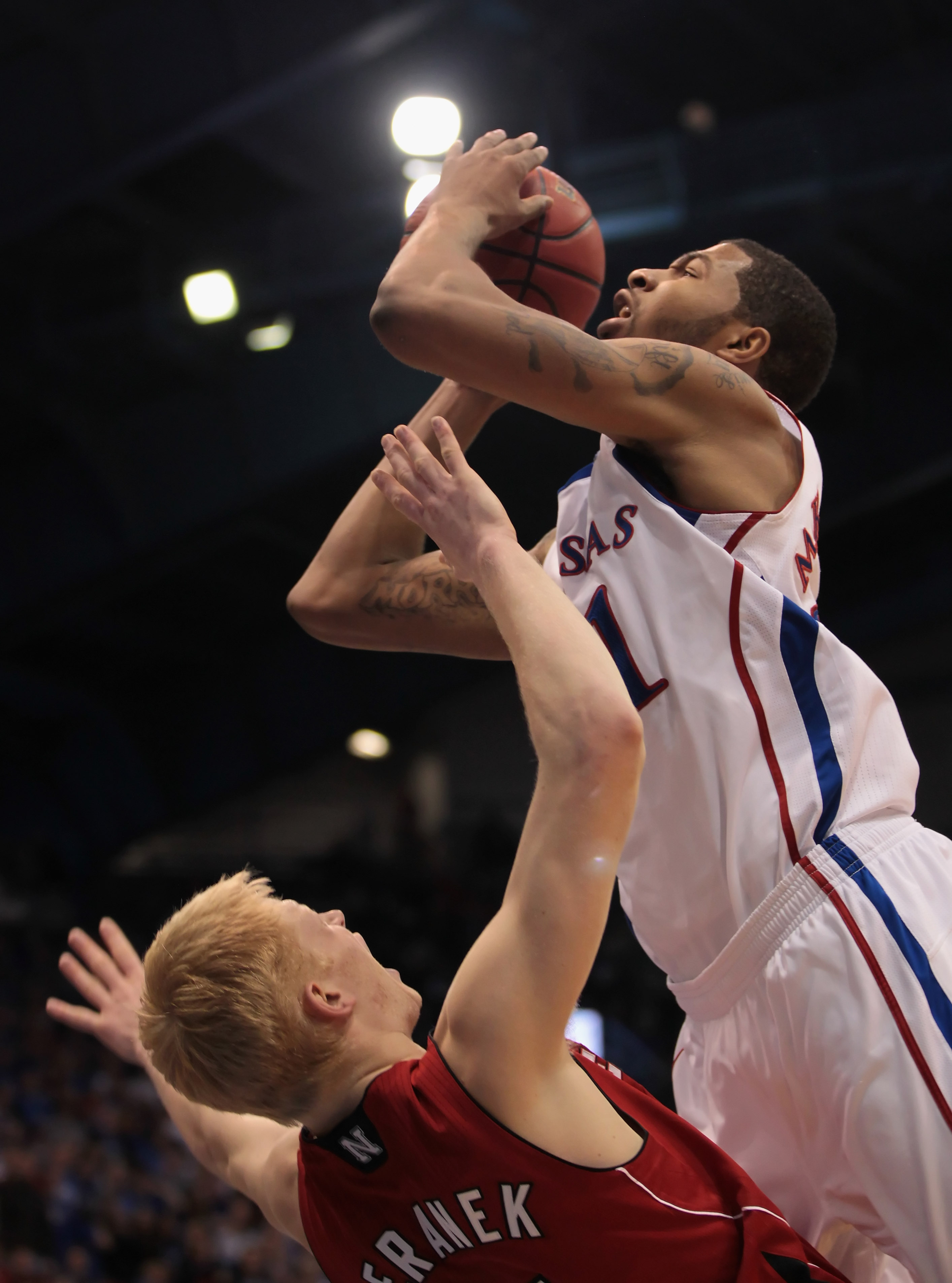 LAWRENCE, KS - JANUARY 15:  Markieff Morris #21 of the Kansas Jayhawks is fouled by Drake Beranek #31 of the Nebraska Cornhuskers during the game on January 15, 2011 at Allen Fieldhouse in Lawrence, Kansas.  (Photo by Jamie Squire/Getty Images)
