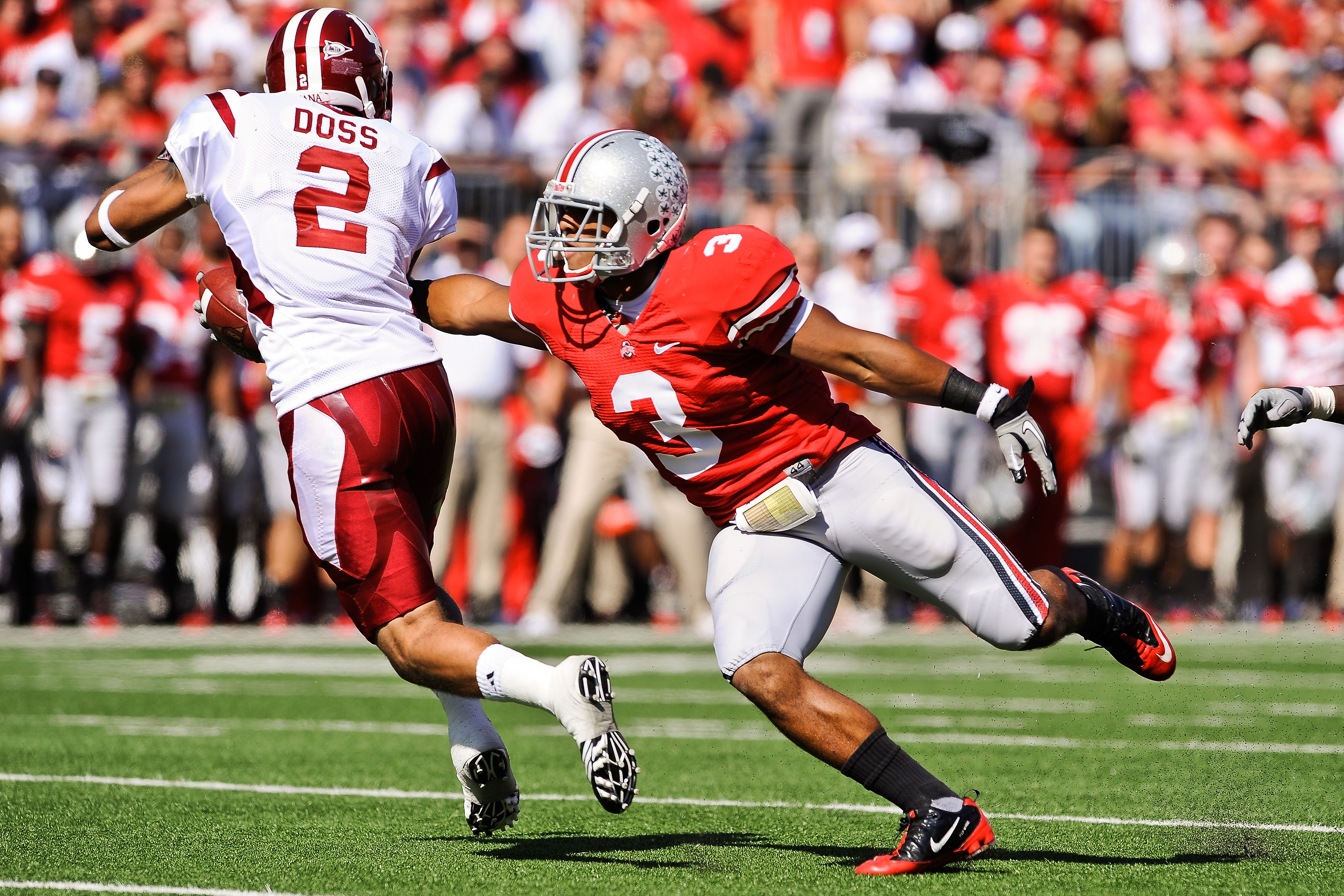 COLUMBUS, OH - OCTOBER 9:  Brandon Saine #3 of the Ohio State Buckeyes attempts to make a tackle on Tandon Doss #2 of the Indiana Hoosiers during a kickoff return at Ohio Stadium on October 9, 2010 in Columbus, Ohio.  (Photo by Jamie Sabau/Getty Images)