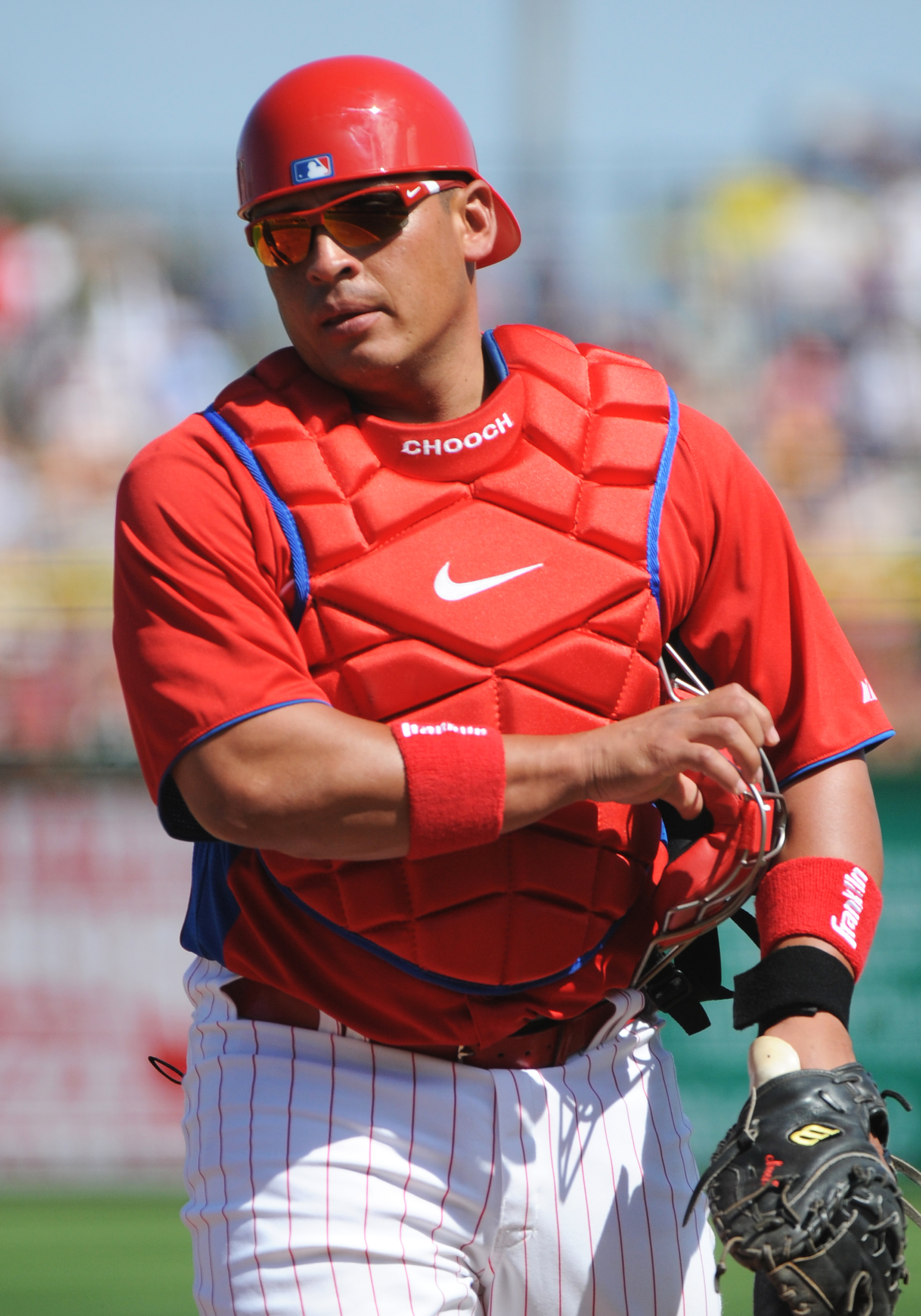 CLEARWATER, FL - FEBRUARY 27:  Catcher Carlos Ruiz #51 of the Philadelphia Phillies sets for play against the New York Yankees February 27, 2011 at Bright House Field in Clearwater, Florida.  (Photo by Al Messerschmidt/Getty Images)