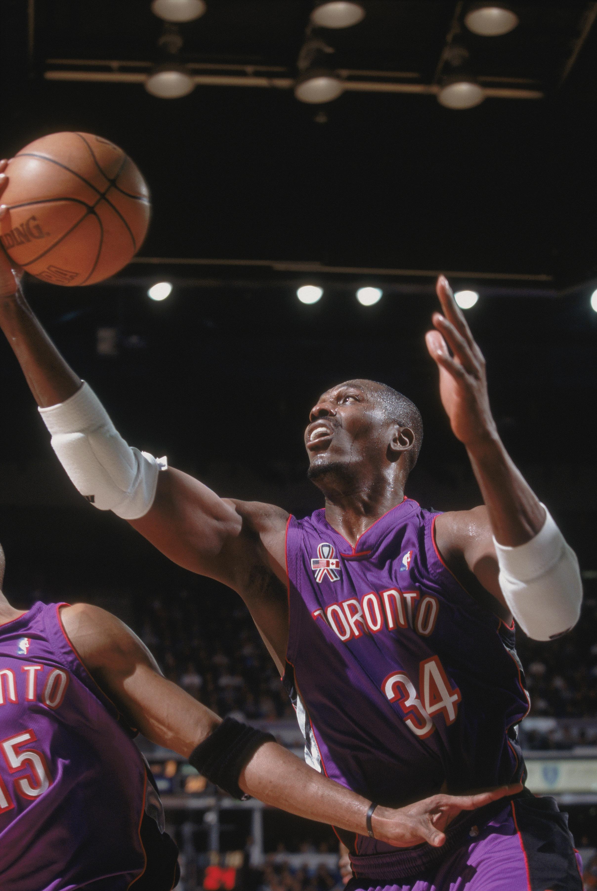 0727268417d 14 Nov 2001  Center Hakeem Olajuwon  34 of the Toronto Raptors grabs the  ball
