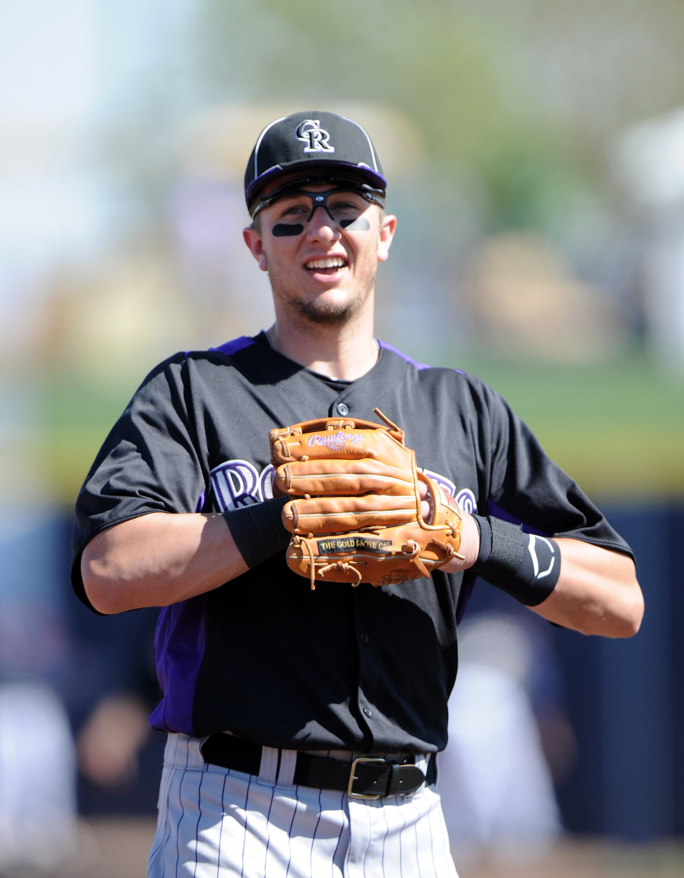 PEORIA, AZ - MARCH 02:  Troy Tulowitzki #2 of the Colorado Rockies smiles on the field against the San Diego Padres during spring training at Peoria Stadium on March 2, 2011 in Peoria, Arizona.  (Photo by Harry How/Getty Images)